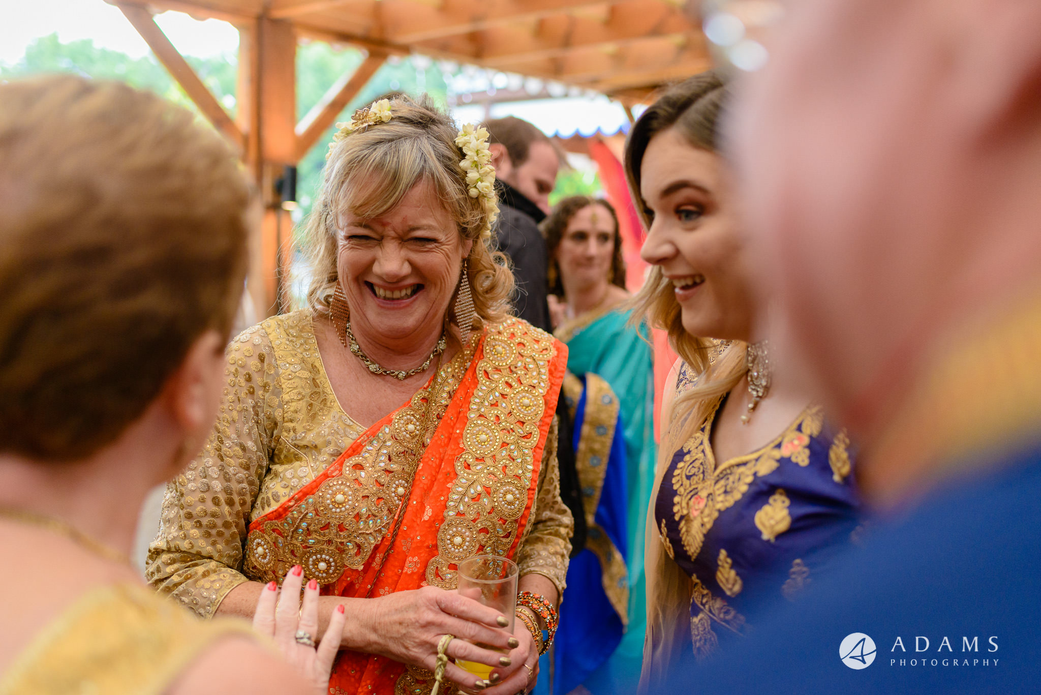walled garden orchardleigh wedding mother of the bride is chatting with family and guests