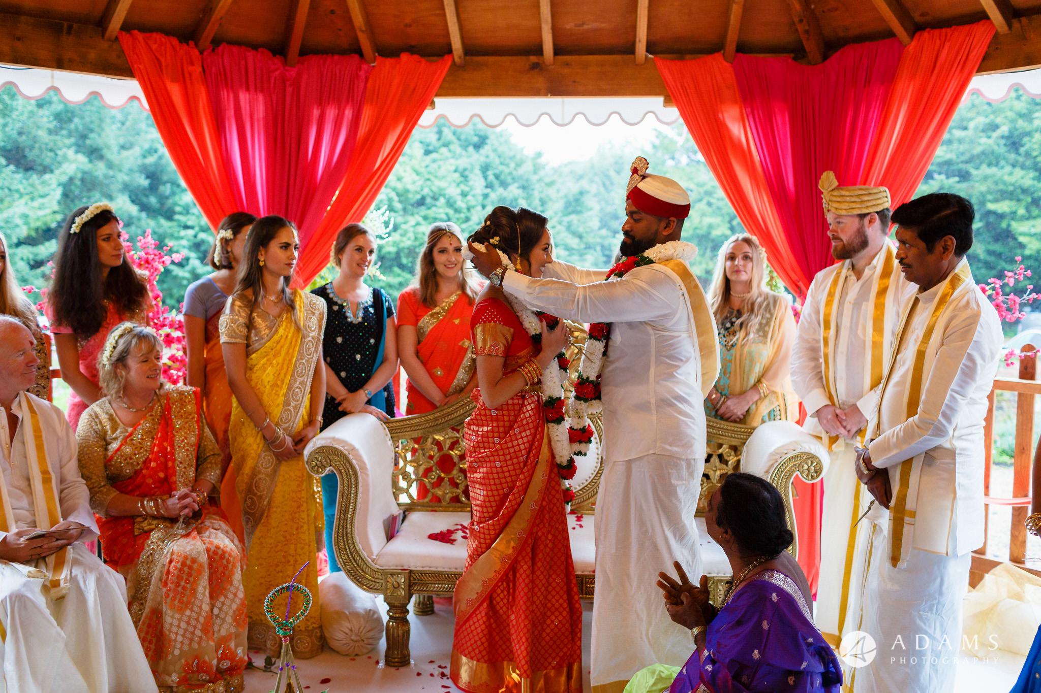 walled garden orchardleigh wedding groom and bride exchange the garlands