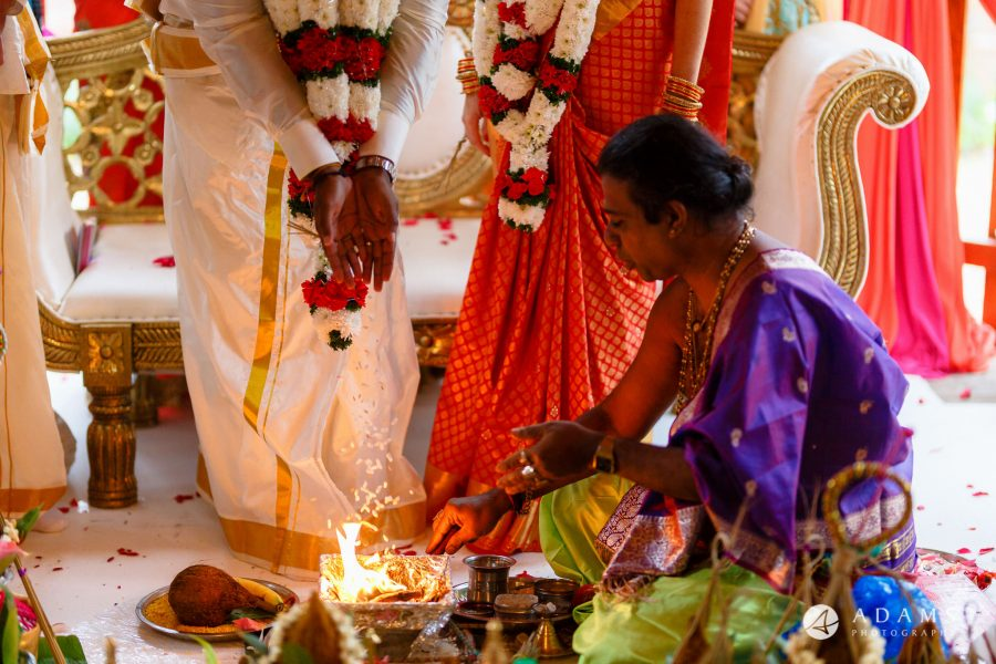 walled garden orchardleigh wedding priest is doing the puja