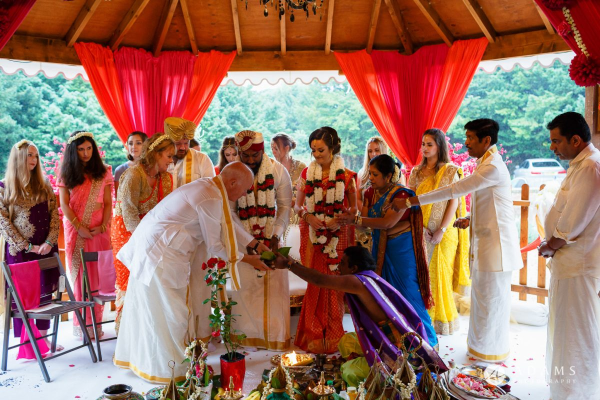 walled garden orchardleigh wedding photographer father receiving puja