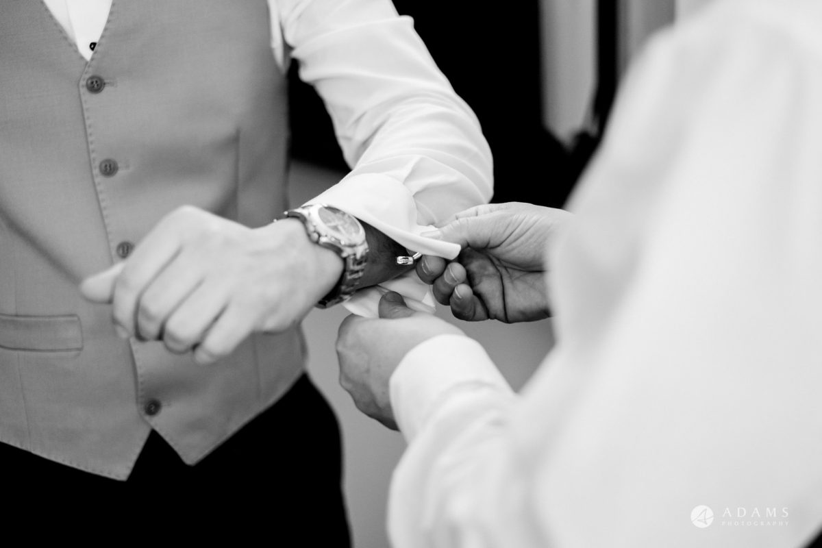grand connaught rooms wedding groom shows his watch