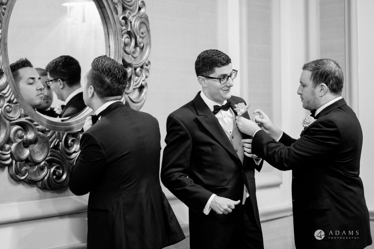 grand connaught rooms wedding groom is fixing his suit