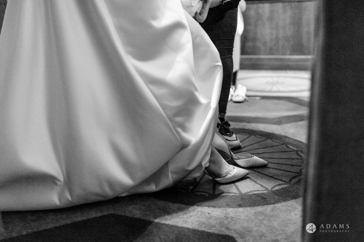 grand connaught rooms wedding bride putting on her shoes