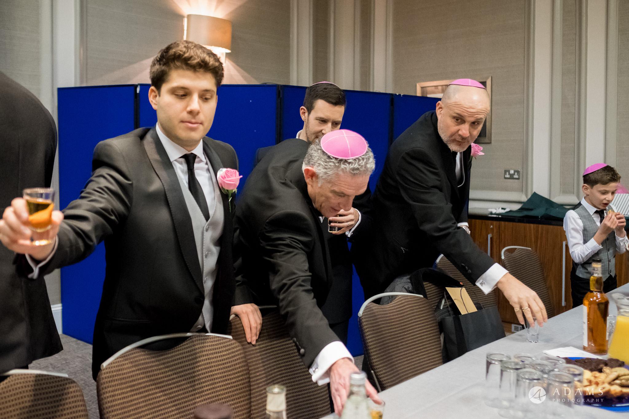 grand connaught rooms wedding men are having tisch