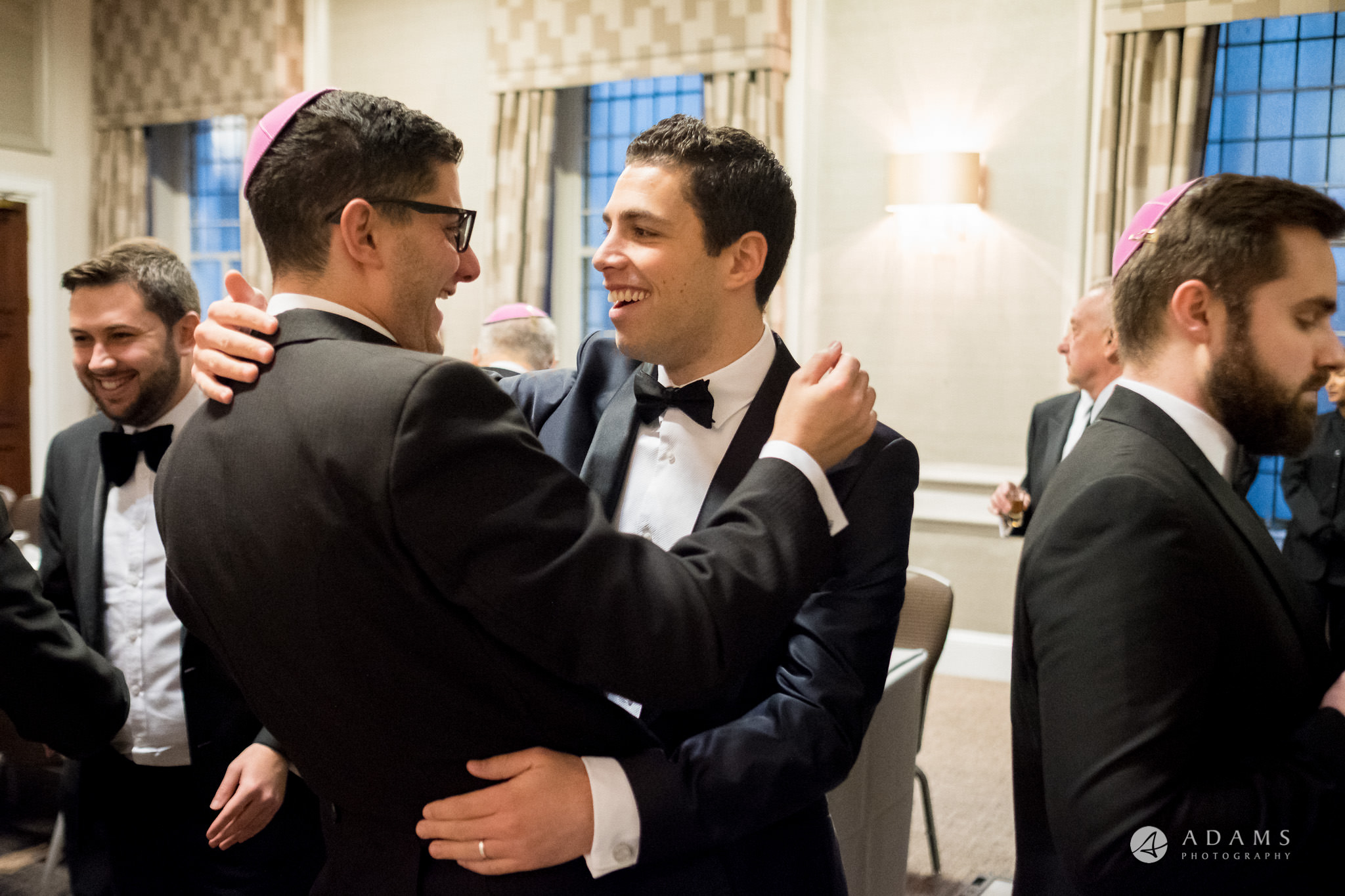 grand connaught rooms wedding groom is hugging his friend
