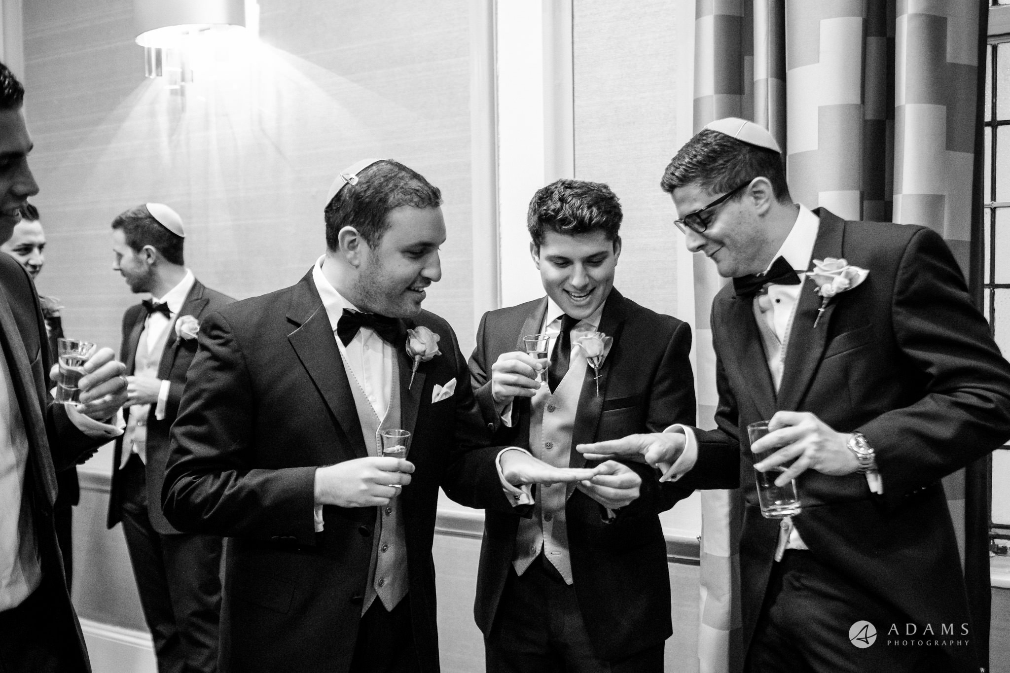 grand connaught rooms wedding groom and his mates are checking the hands and the rings