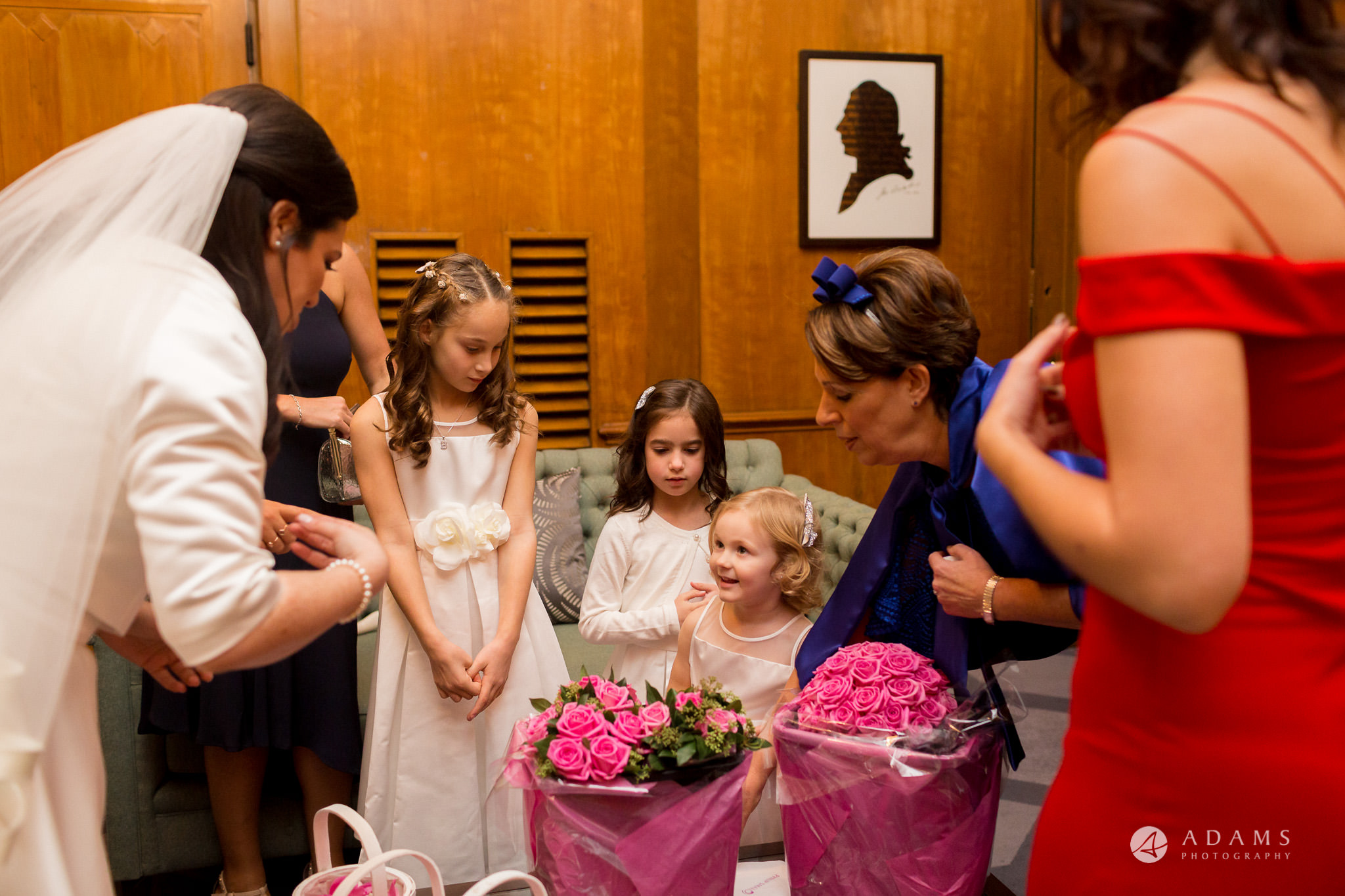 grand connaught rooms wedding flower-girls are looking on the bride