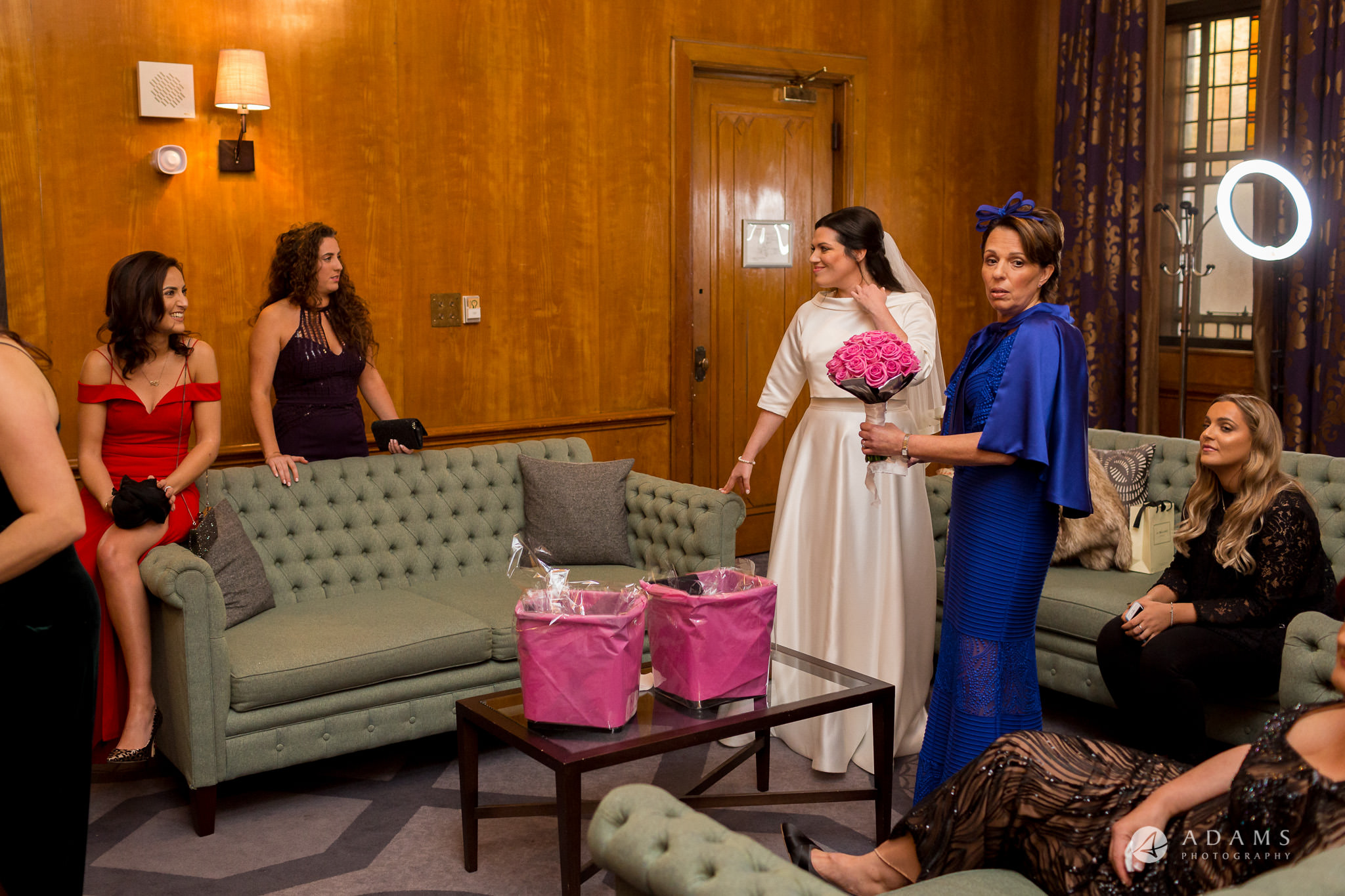grand connaught rooms wedding mother of the bride is holding bouquet