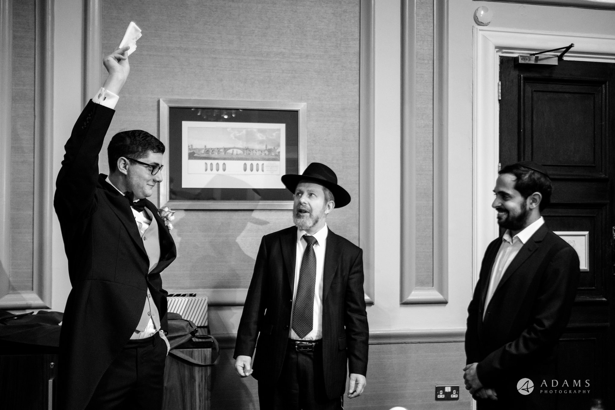 grand connaught rooms wedding grooms at the tisch rises his hand