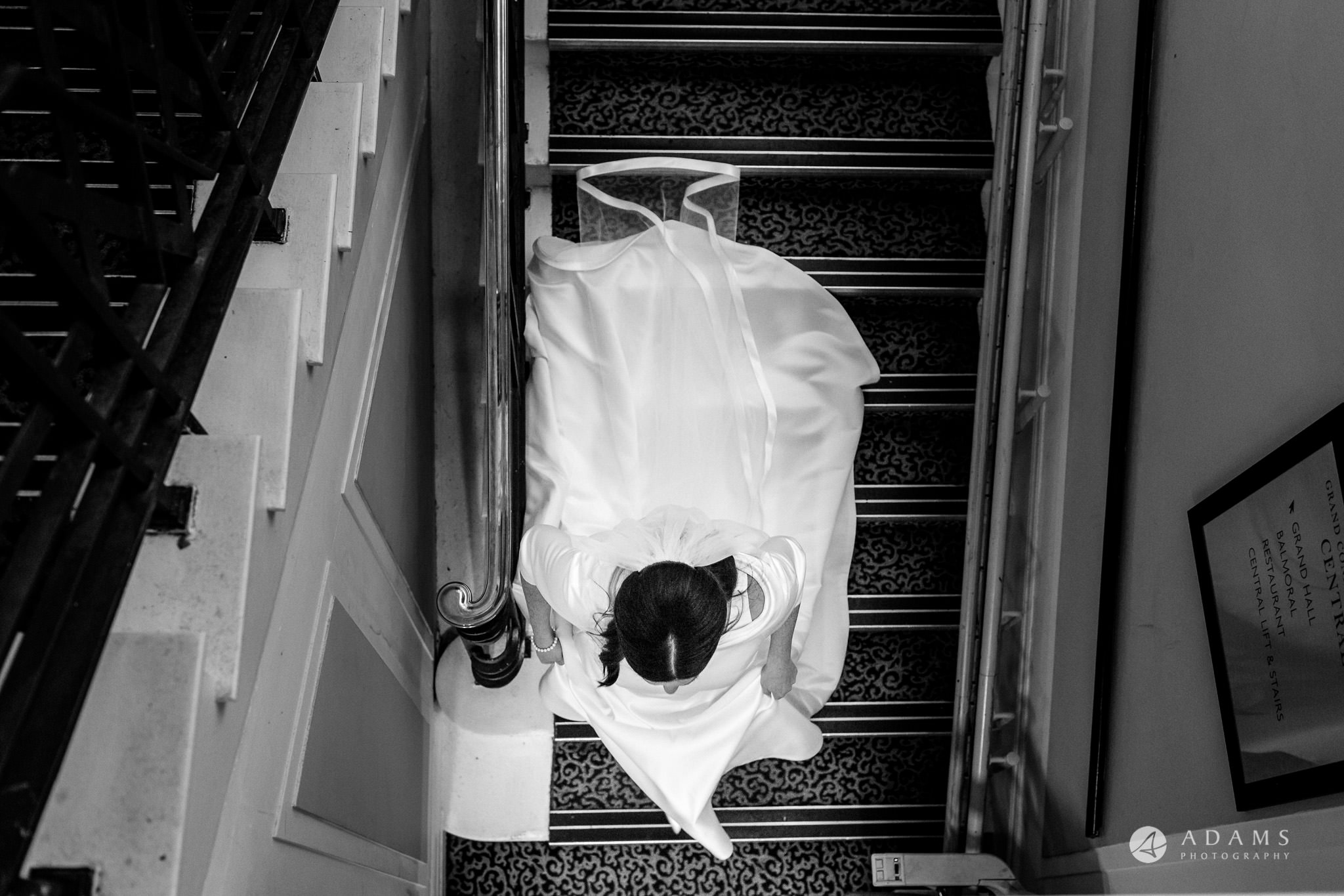 grand connaught rooms wedding bride is walking down the stairs
