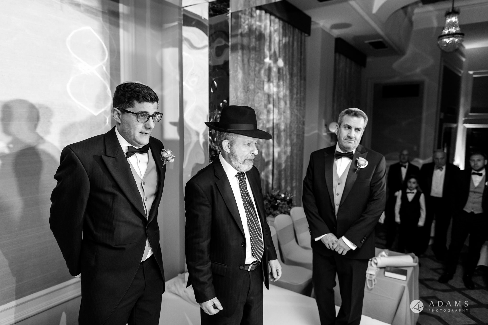 grand connaught rooms wedding rabbi is waiting with the groom for the bride