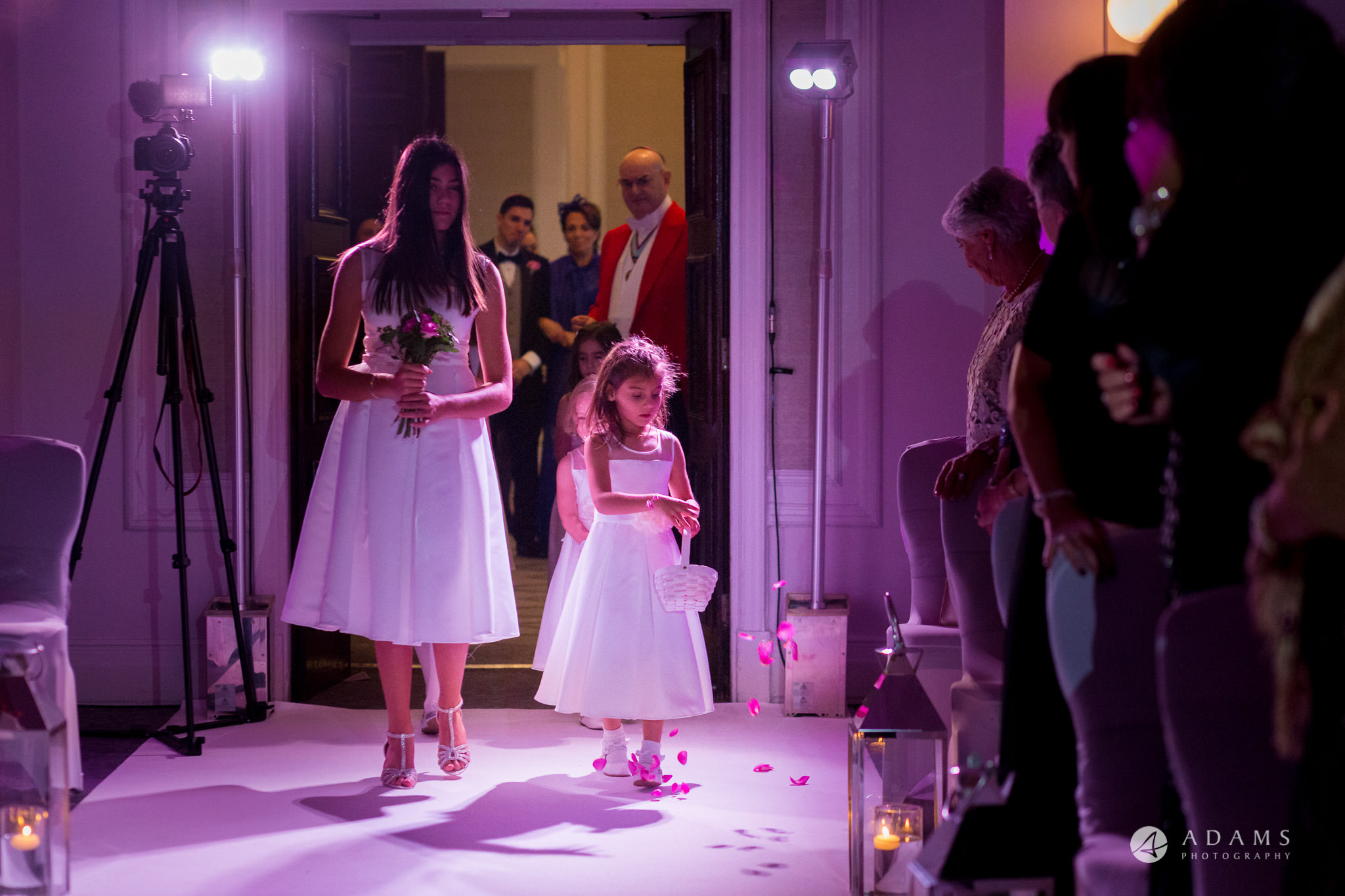 grand connaught rooms wedding flower girls are walking down the aisle