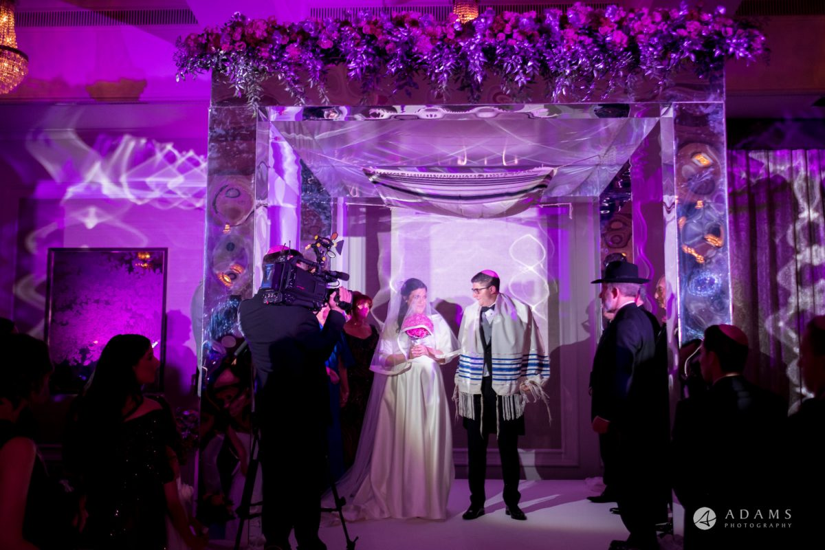 grand connaught rooms wedding bride and groom under Jewish chuppah