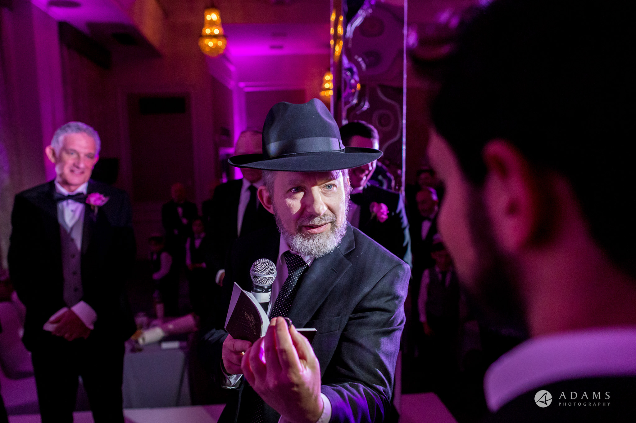 grand connaught rooms wedding rabbi is checking the ring