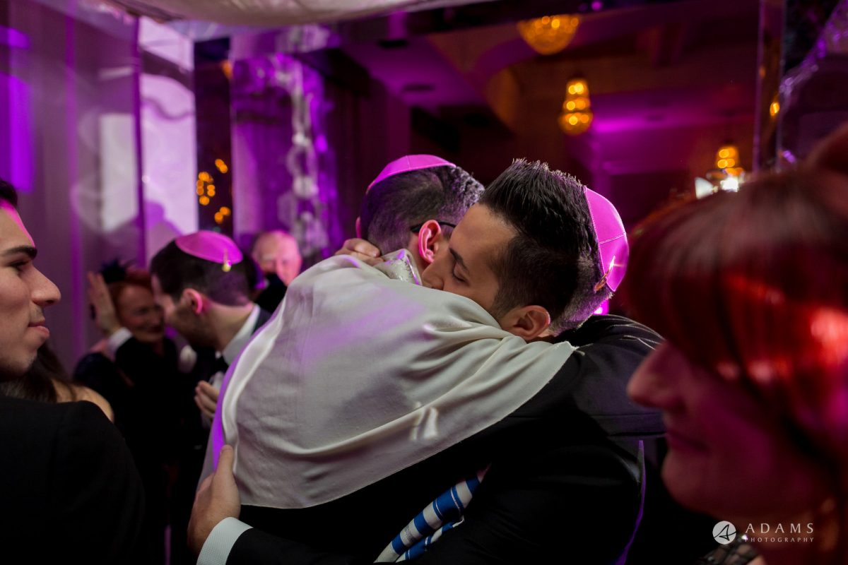 De Vere grand connaught rooms groom hugs his bestman under chuppah