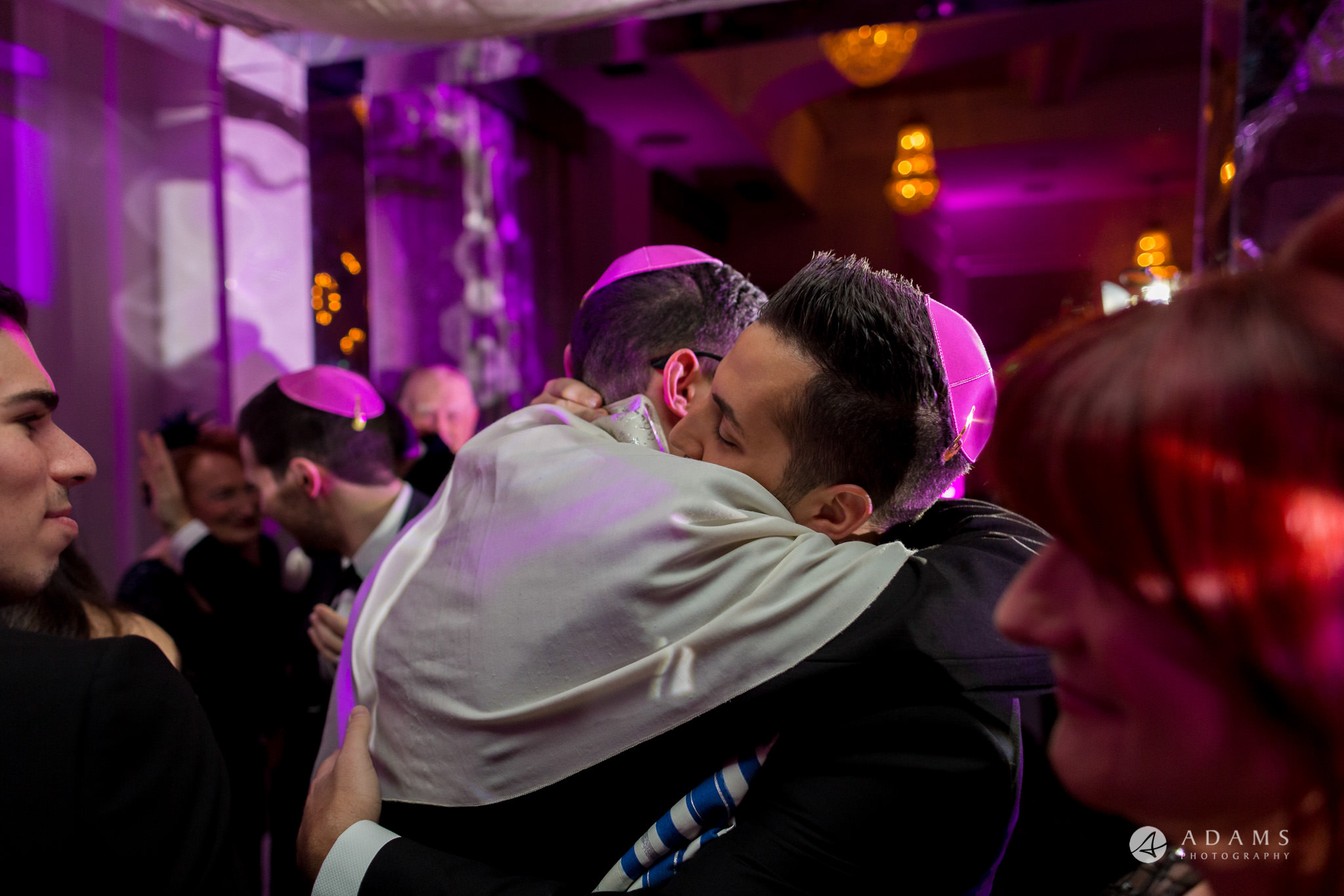 De Vere grand connaught rooms groom hugs his bestman under chuppah