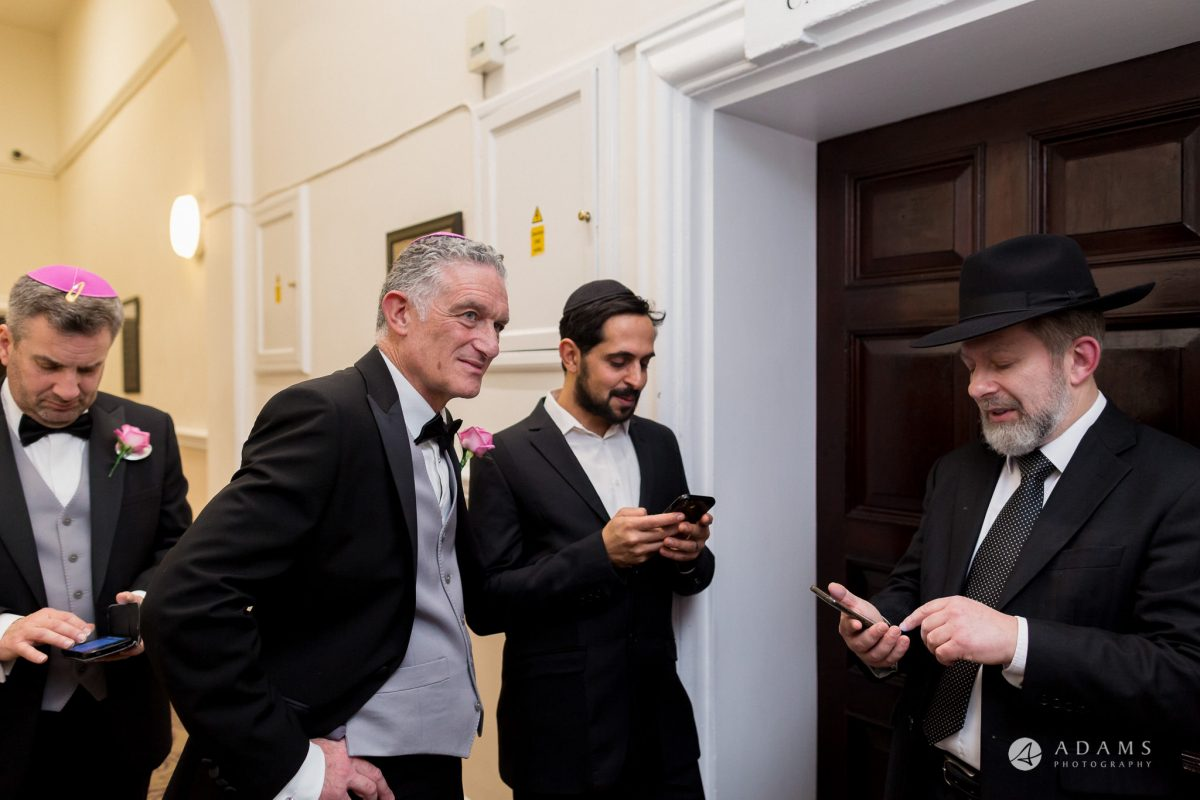 De Vere grand connaught rooms family and rabbi waits outside of the room while the couple have their time