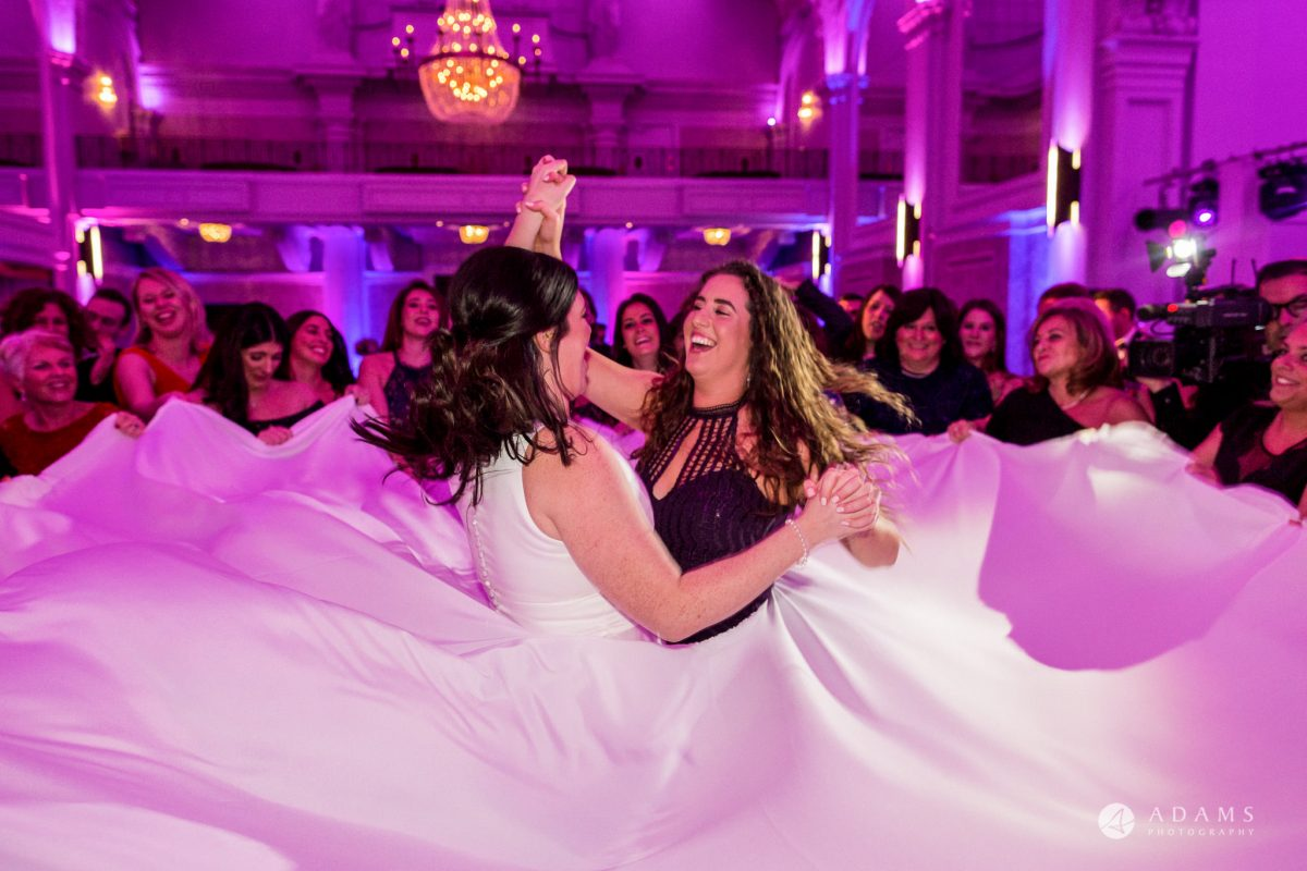 De Vere grand connaught rooms bride and bridesmaid dance together at Israeli dance