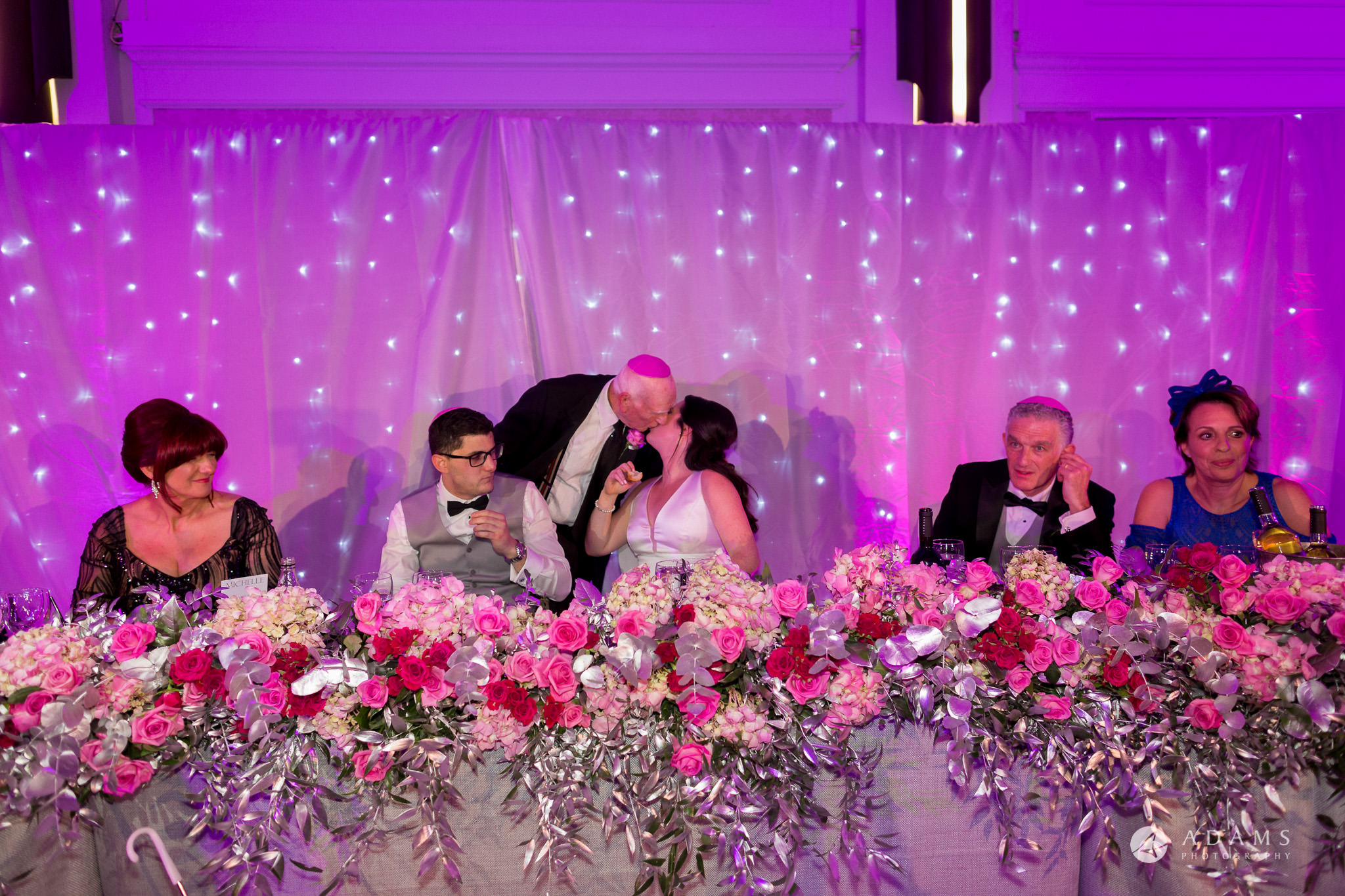 De Vere grand connaught rooms photographer bride is kissing her granddad