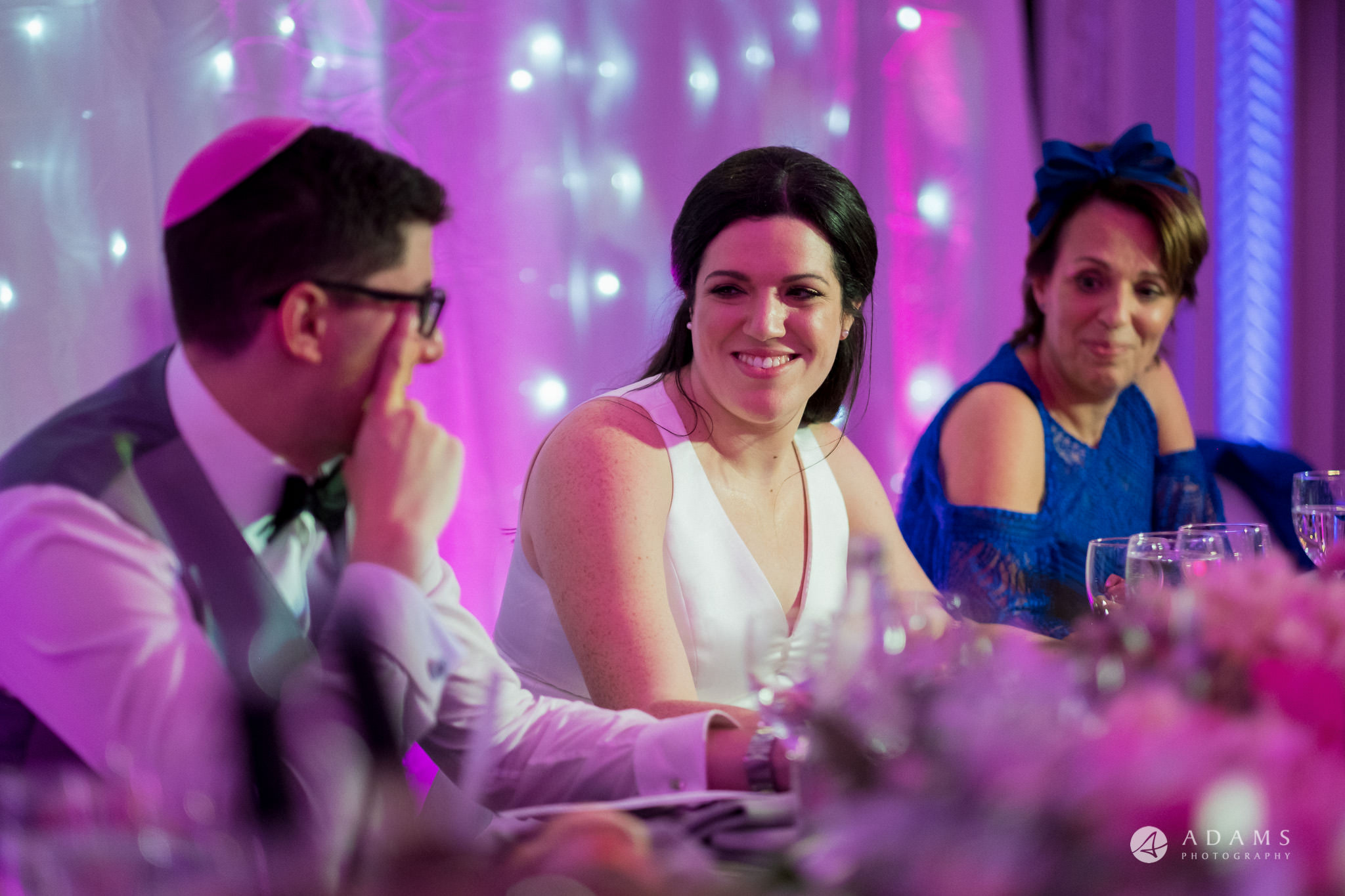 De Vere grand connaught rooms photographer bride looks at the groom