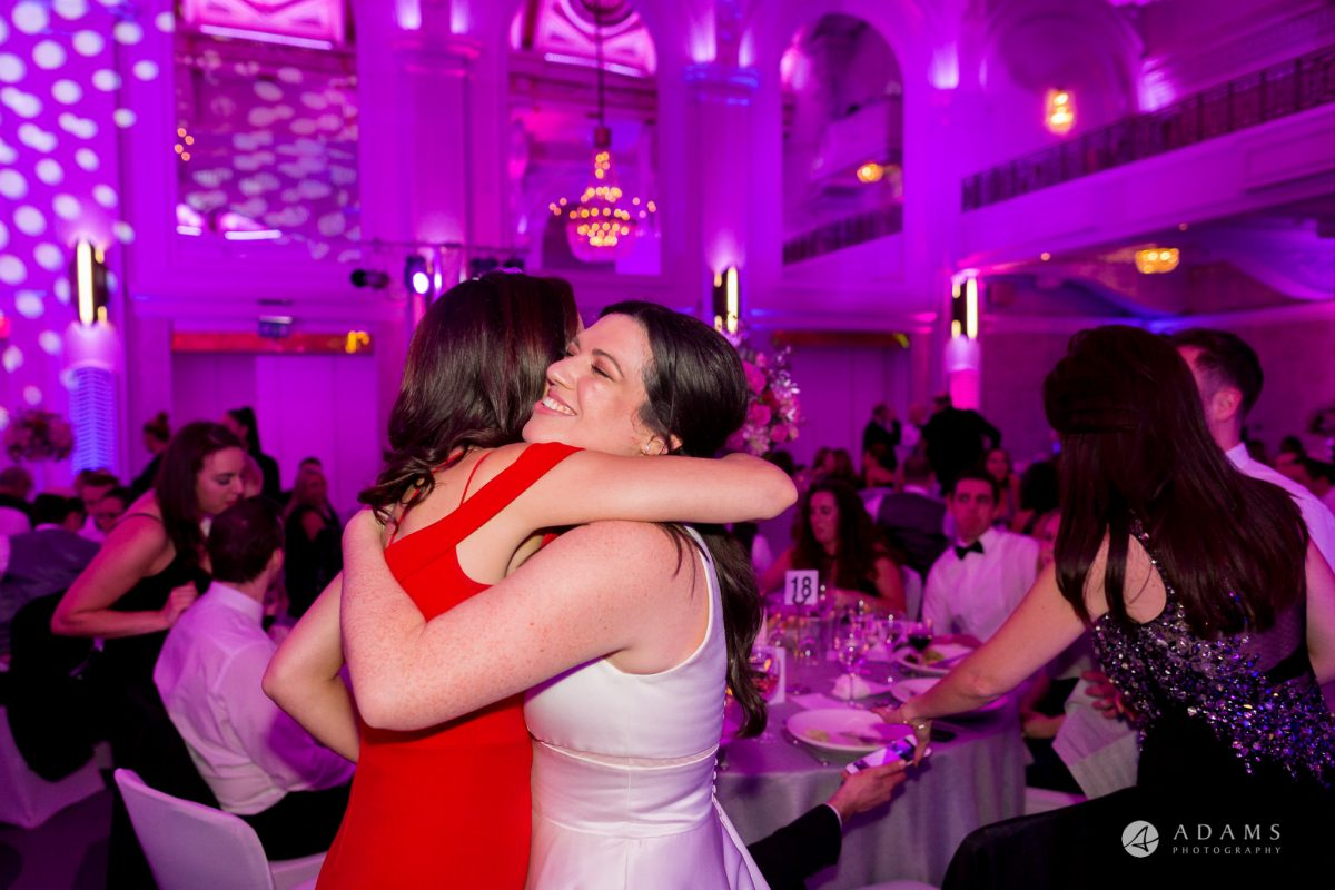 Grand connaught rooms photographer bride hugs bridesmaid
