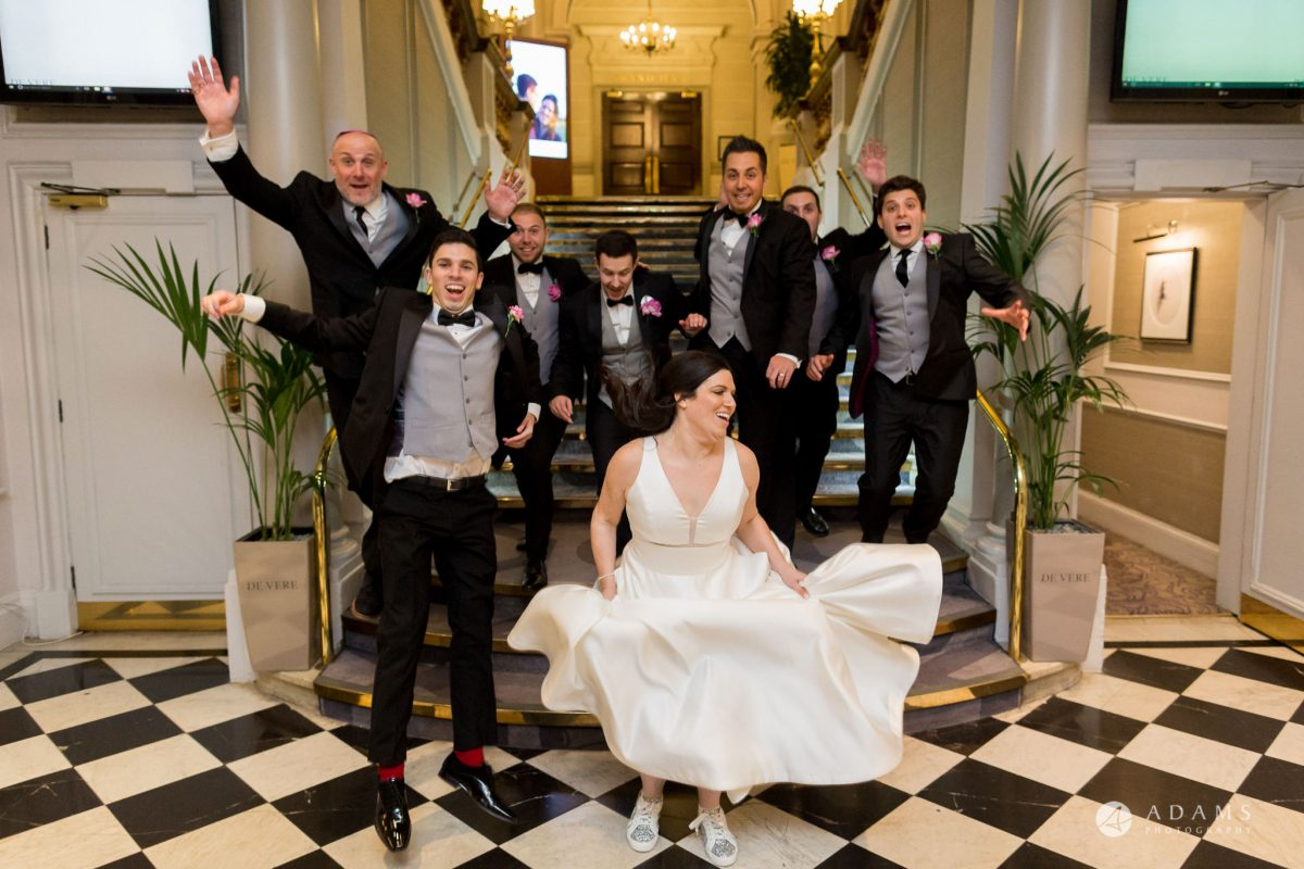 Grand connaught rooms photographer bride in the air while jumping