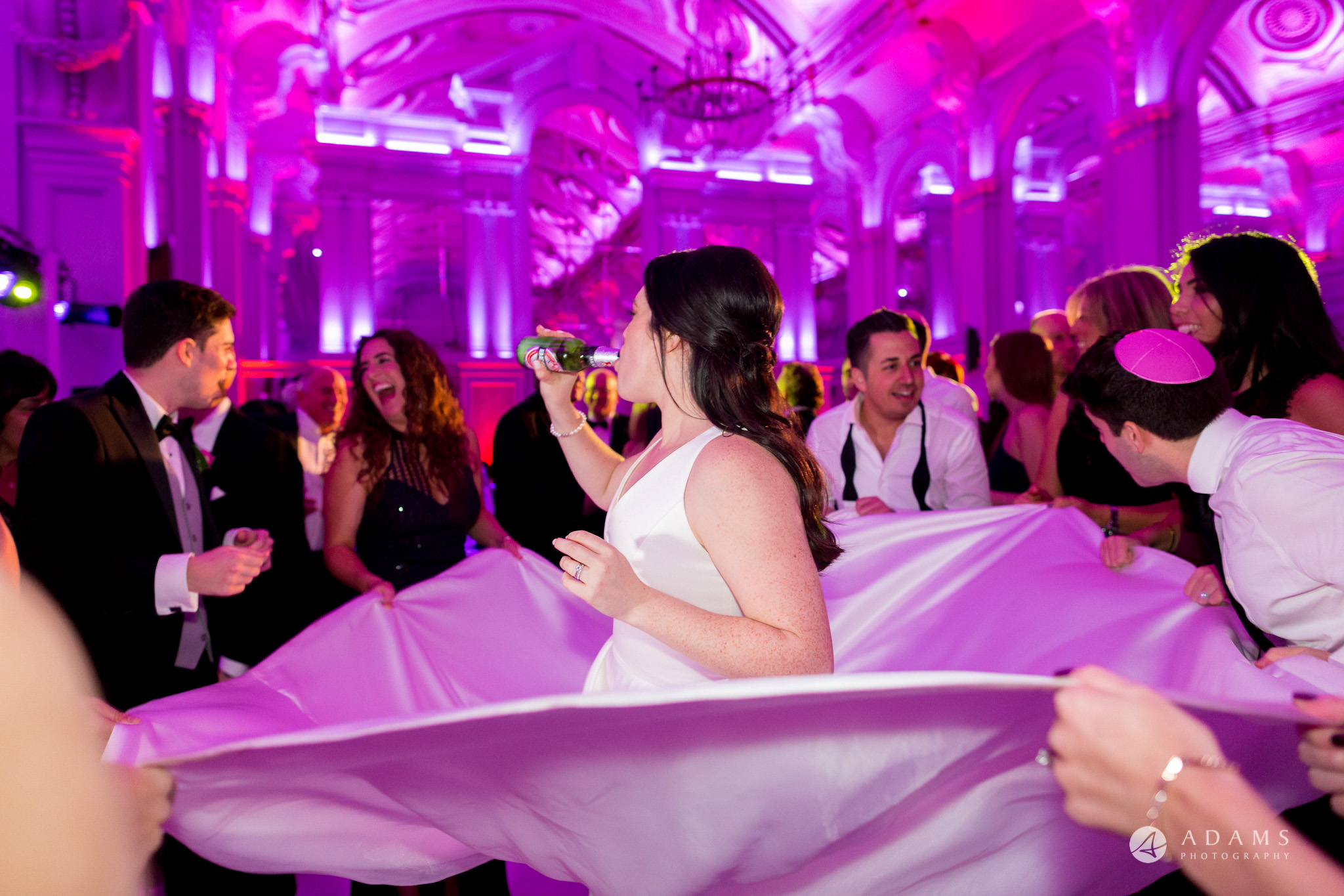 Grand connaught rooms bride drink beer while dancing