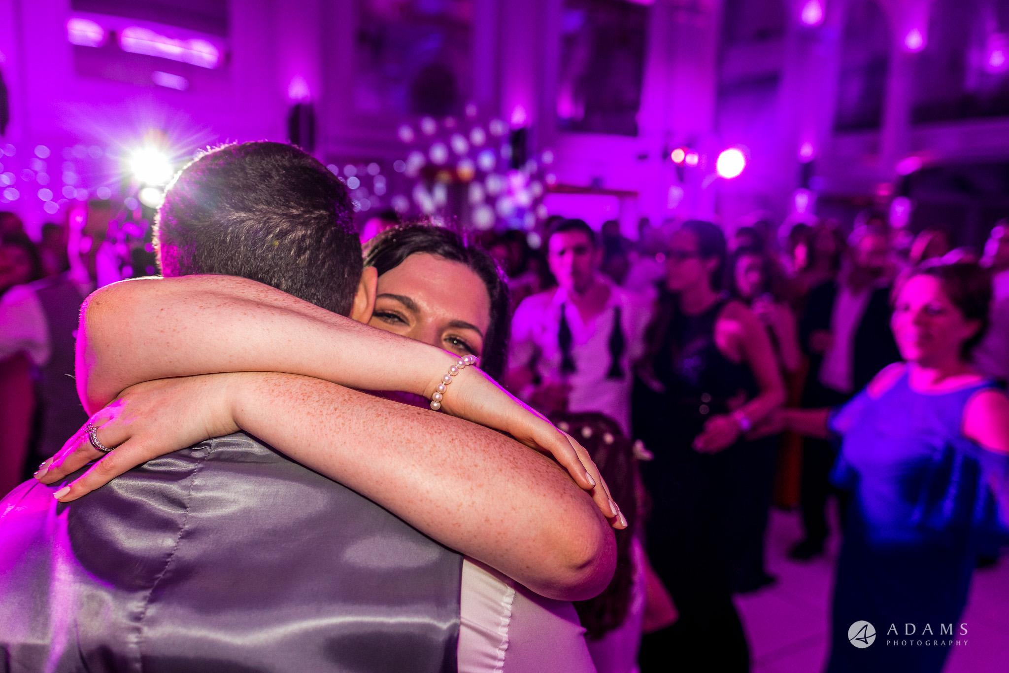 Grand connaught rooms wedding bride hugs groom