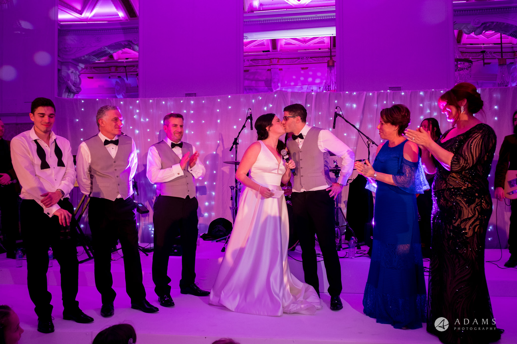 Grand connaught rooms wedding couple kisses each other