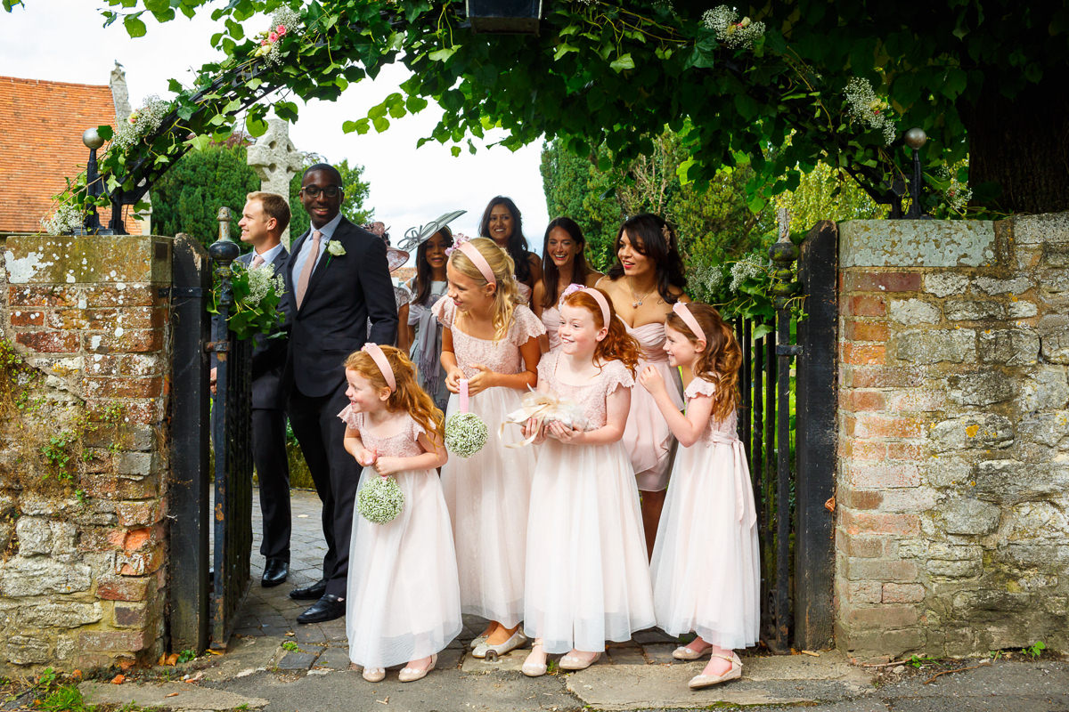 Hertfordshire Wedding Photographer flower girls waitng for the bride to arrive