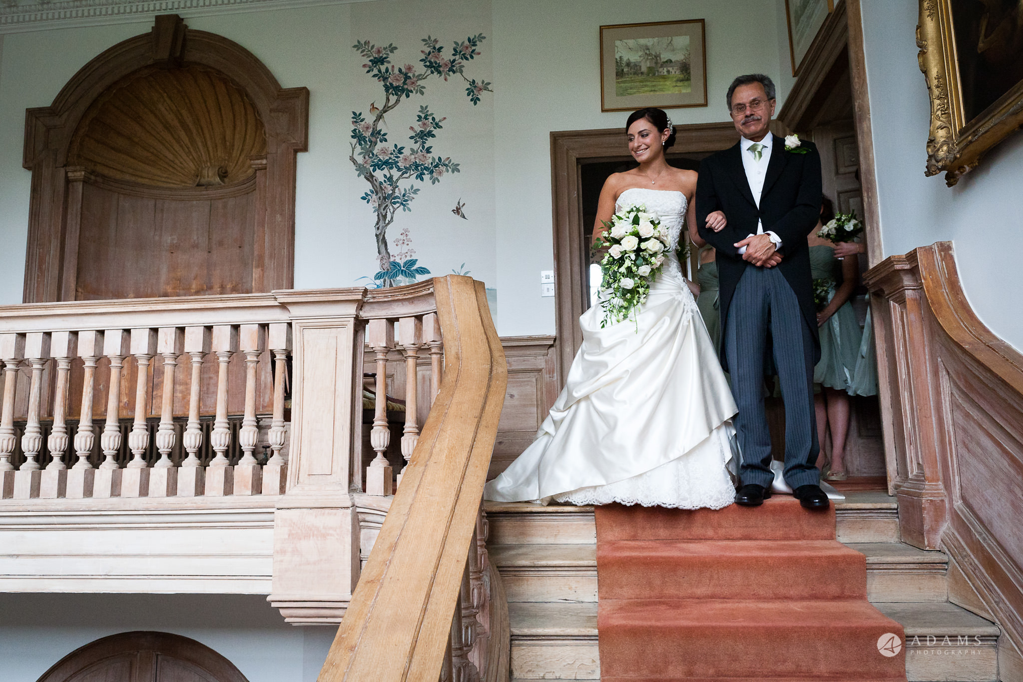 Kingston Bagpuize House wedding bride and her father walking down the stairs