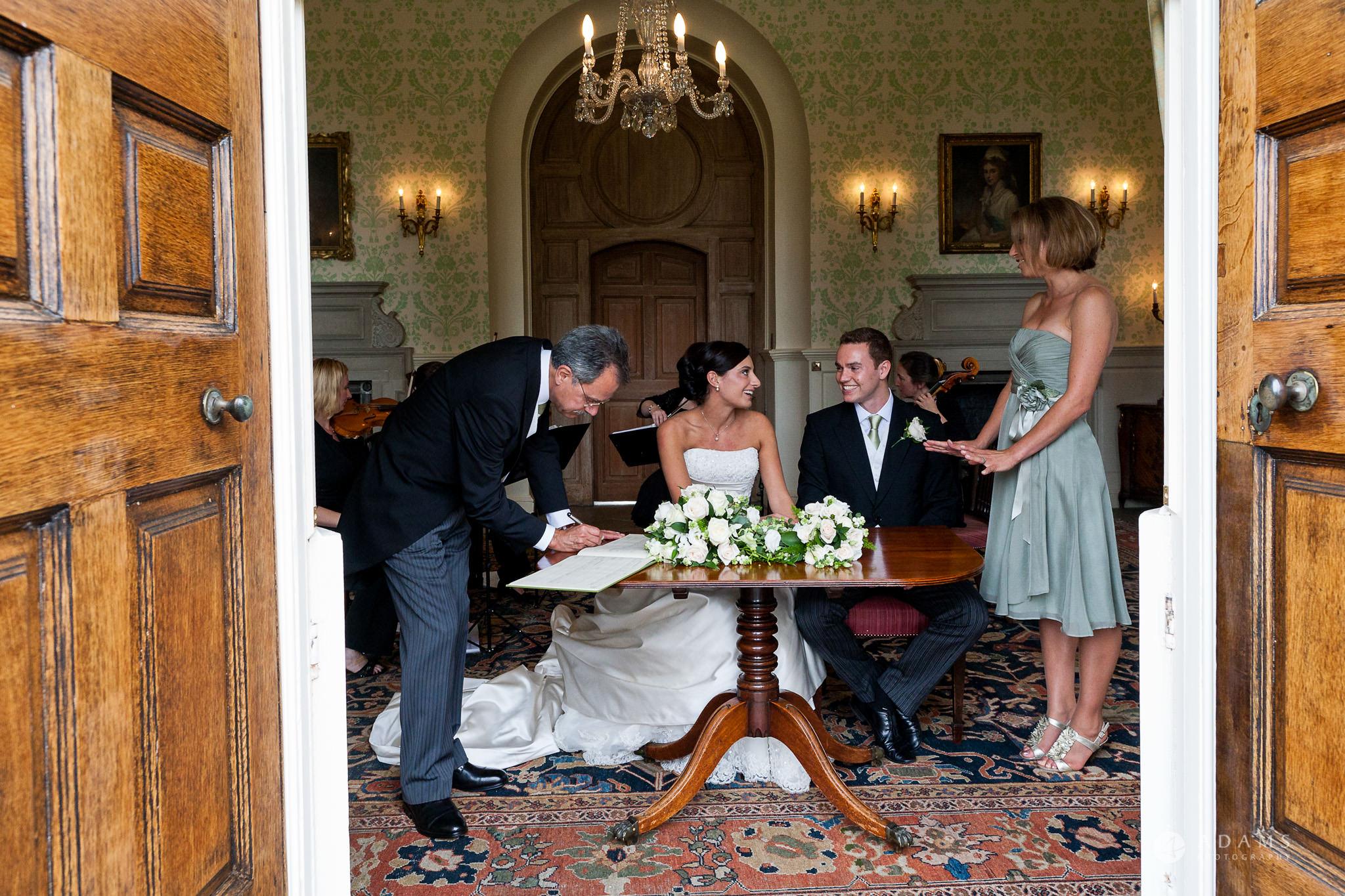 Kingston Bagpuize House wedding signing the registrar