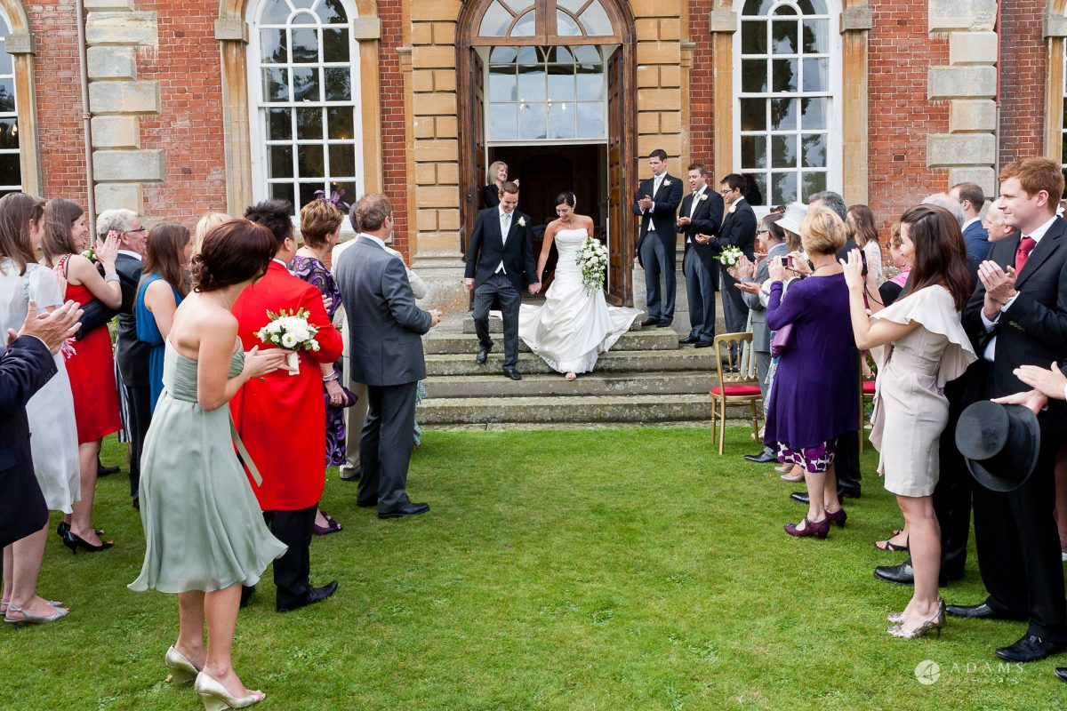 Kingston Bagpuize House wedding married couple walks back together