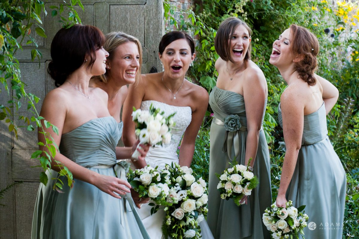 Kingston Bagpuize House wedding bride and bridesmaids laughing