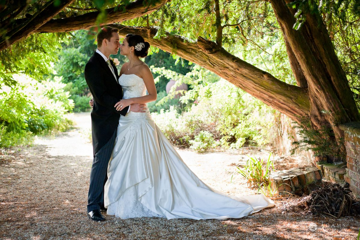 Kingston Bagpuize House wedding couple photo shot under the tree