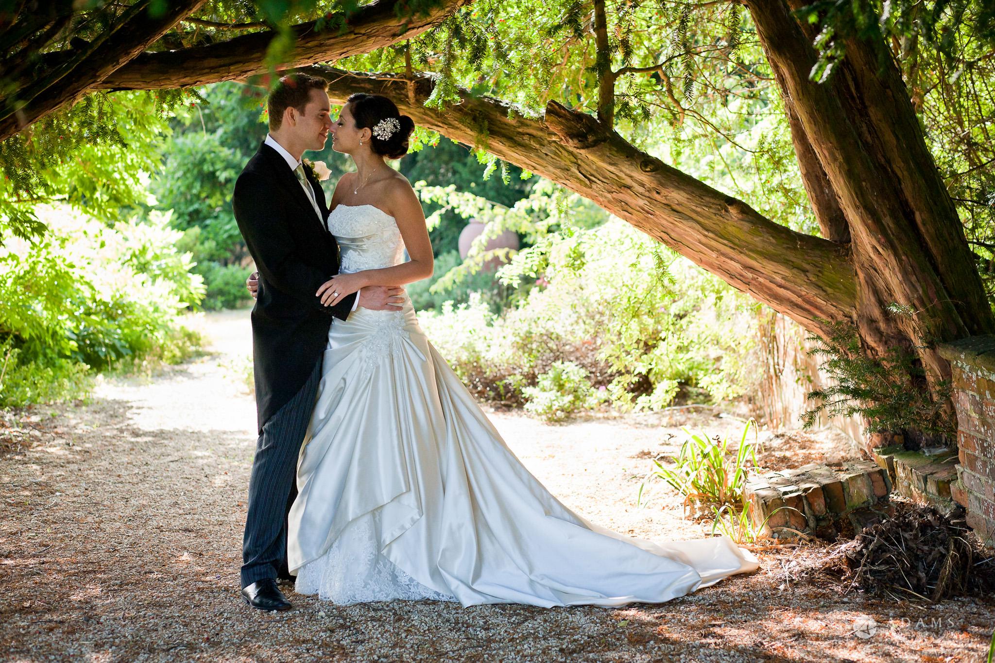 Kingston Bagpuize House wedding couple photo shot under the tree