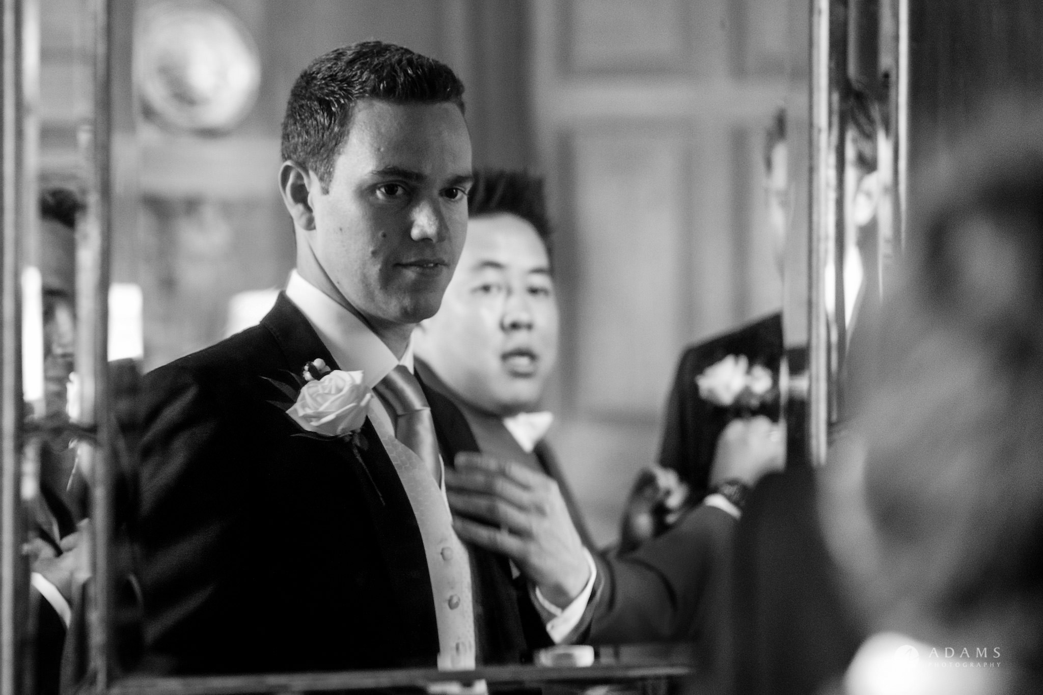 Kingston Bagpuize House wedding groom reflection in the mirror