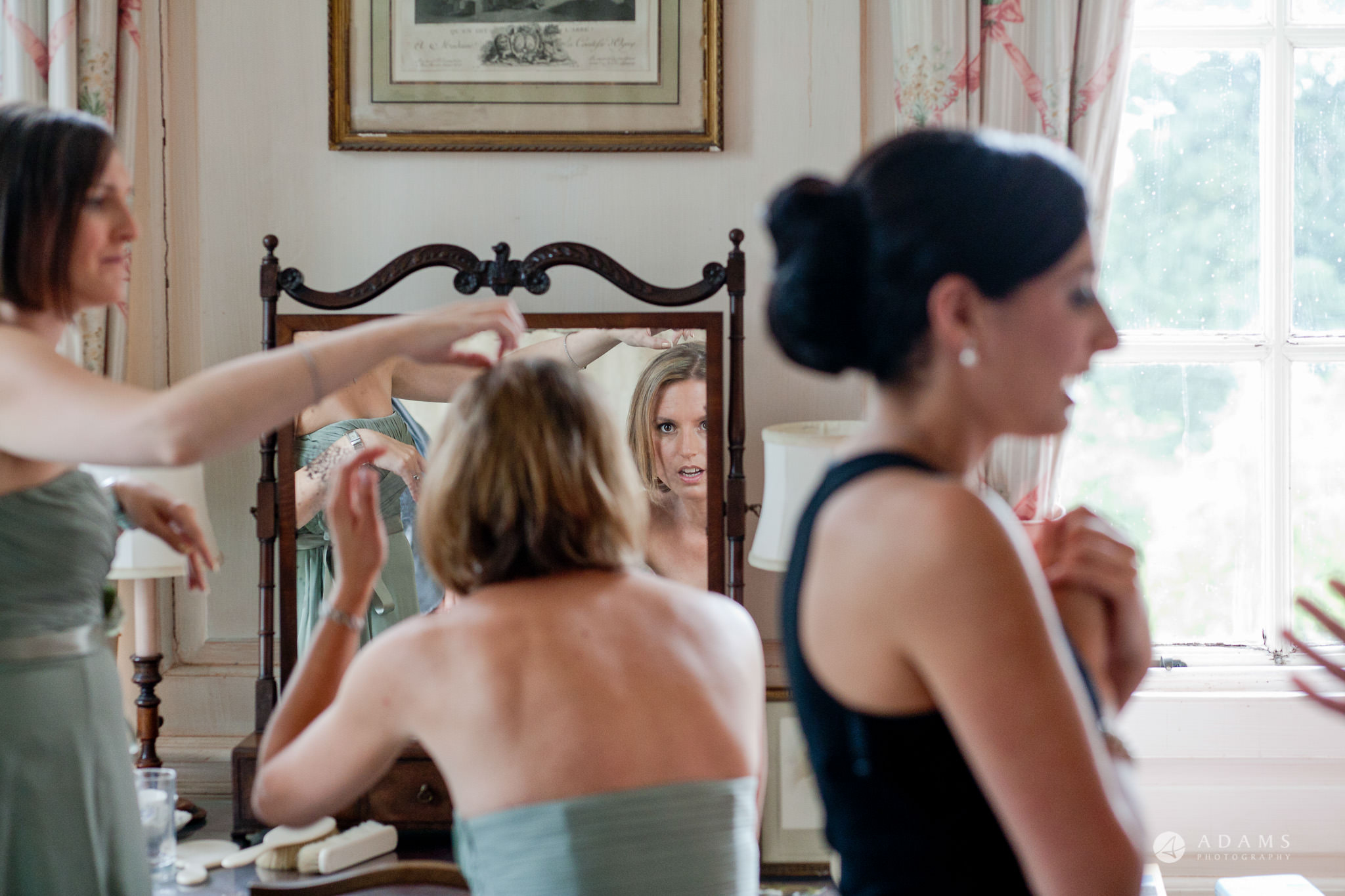 Kingston Bagpuize House wedding bridesmaid reflection in the mirror make up
