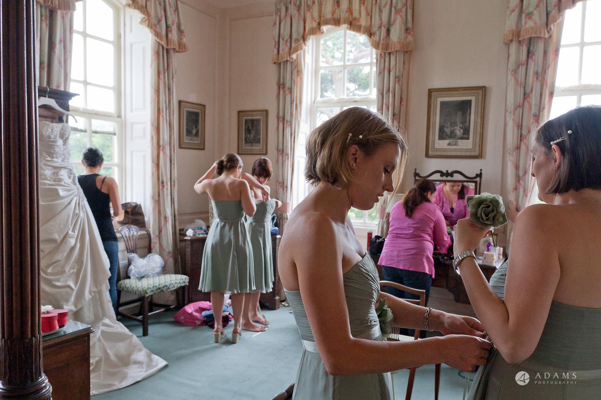 Kingston Bagpuize House wedding bridesmaids fix their dresses