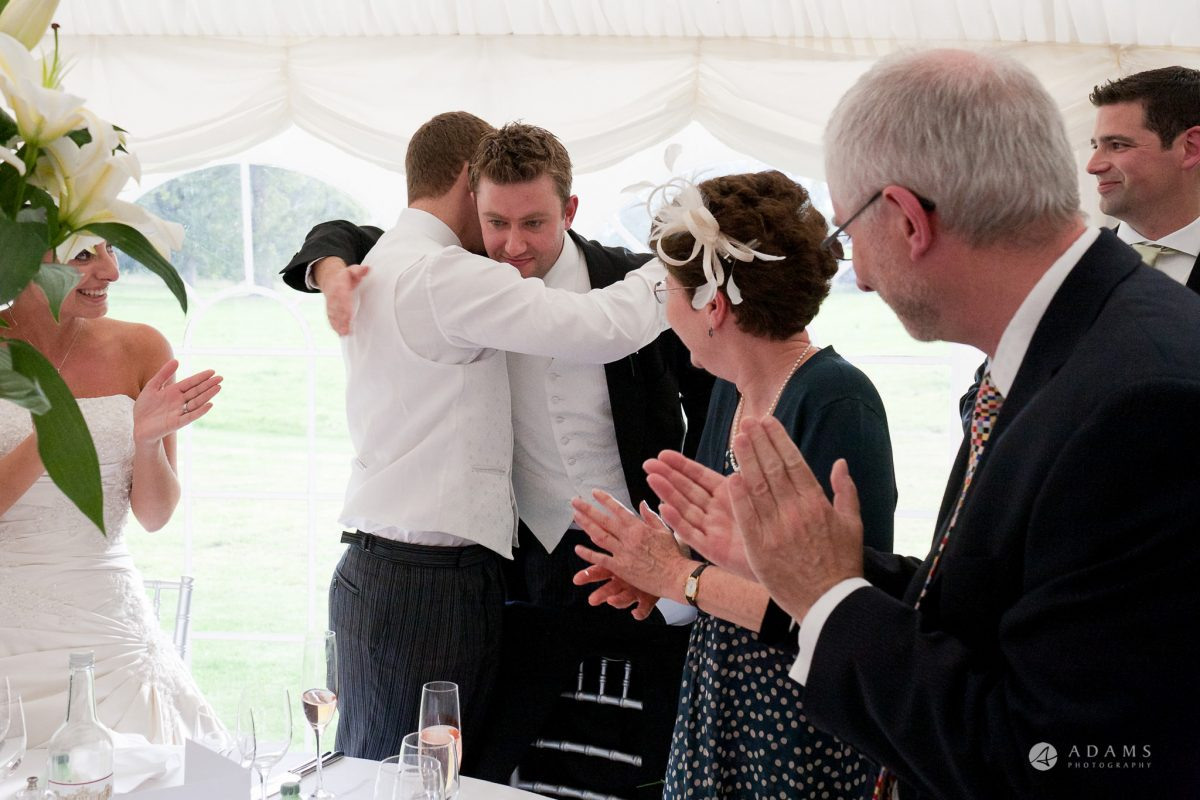 Kingston Bagpuize House wedding groom hugs his bestman