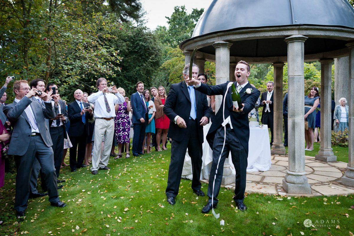 Kingston Bagpuize House wedding champage opened with a sward