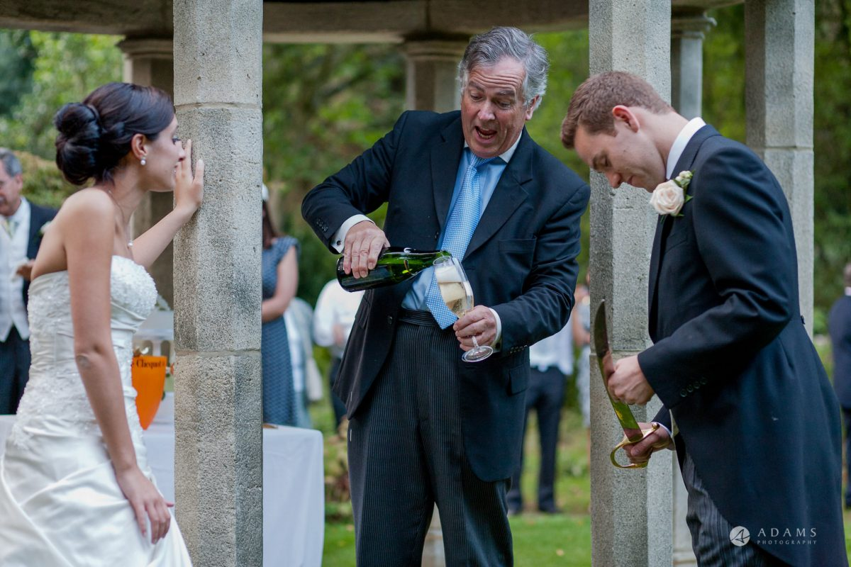 Kingston Bagpuize House wedding toast master pours champagne