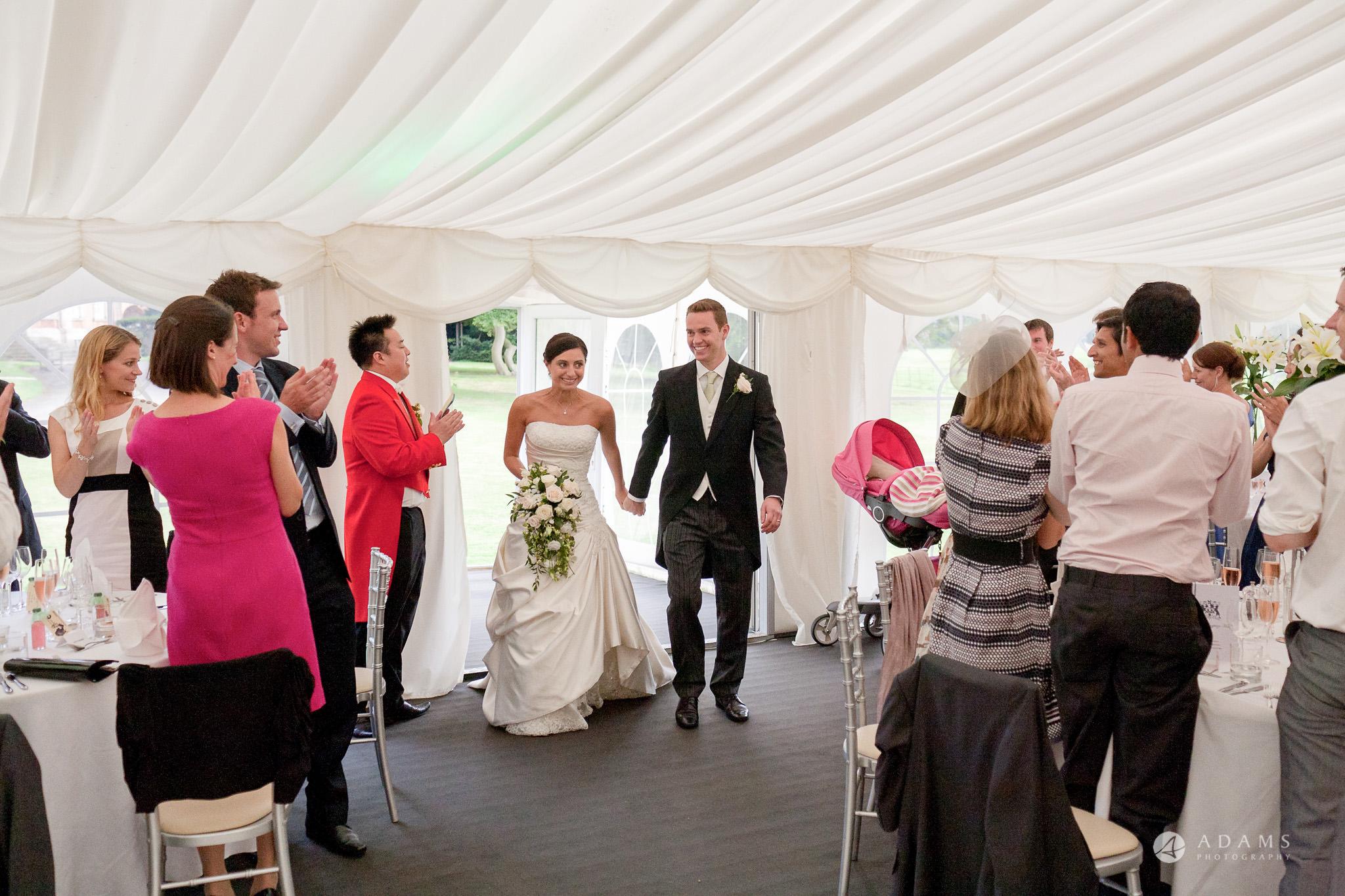 Kingston Bagpuize House wedding couple enter the reception