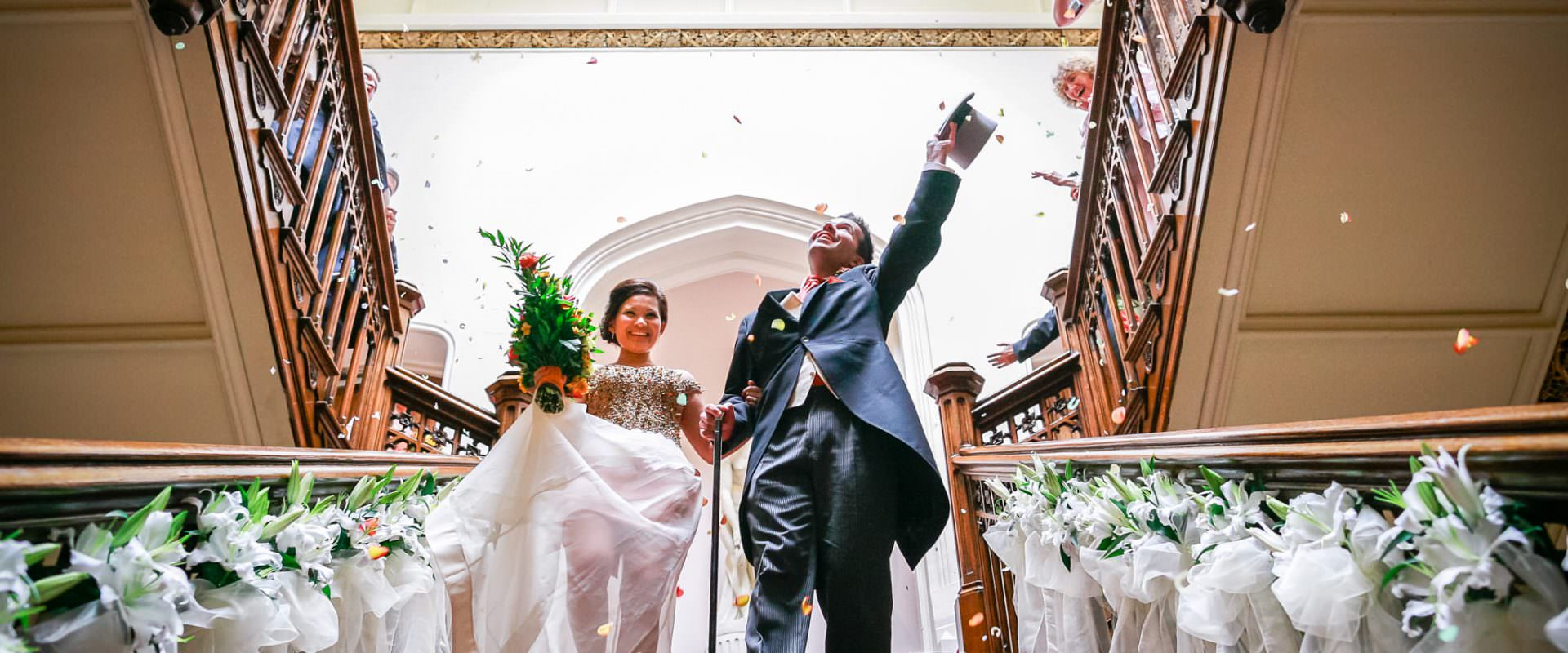 Somerset wedding photographer couple under shower of confetti