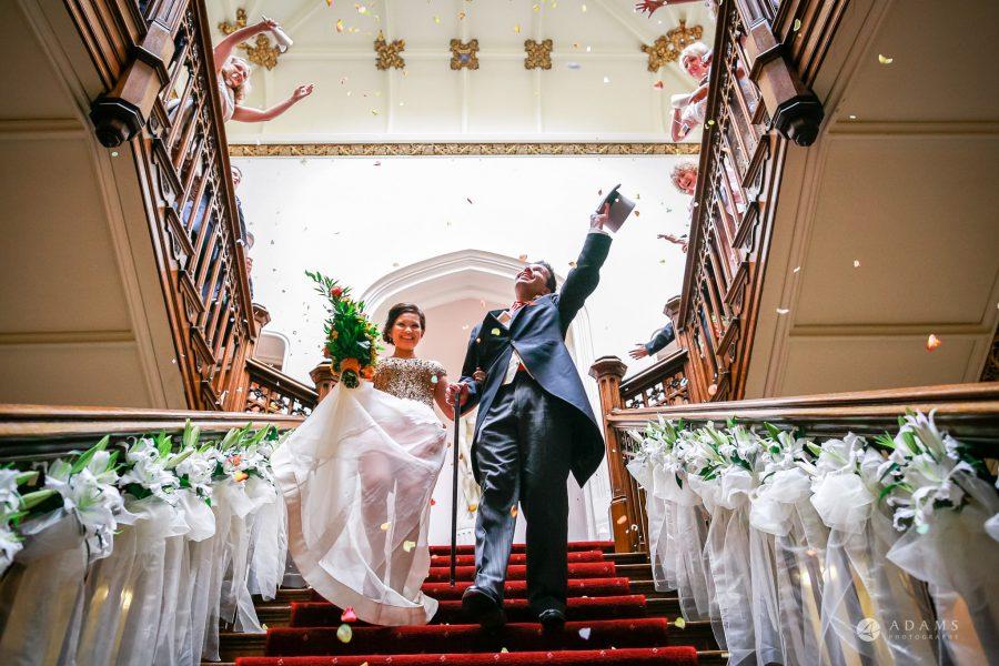 Somerset wedding photographer couple under shower of confetti