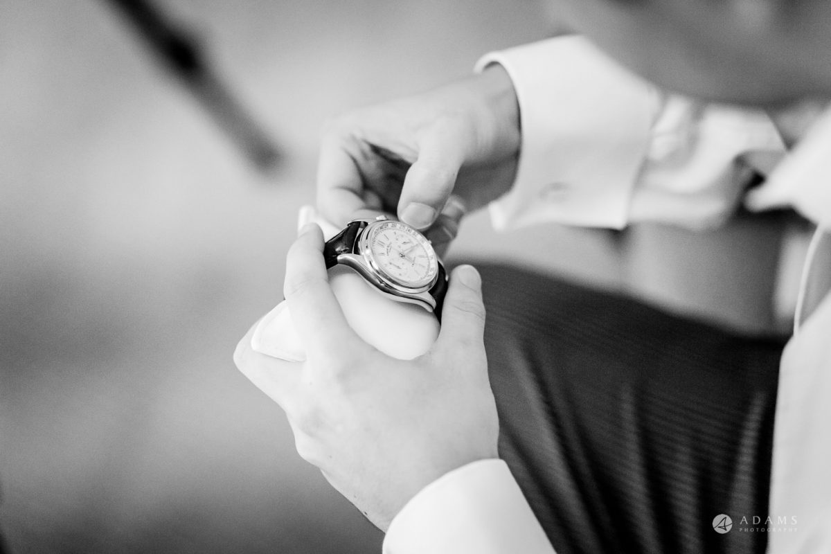 St Audries Park wedding groom looks at his new watch