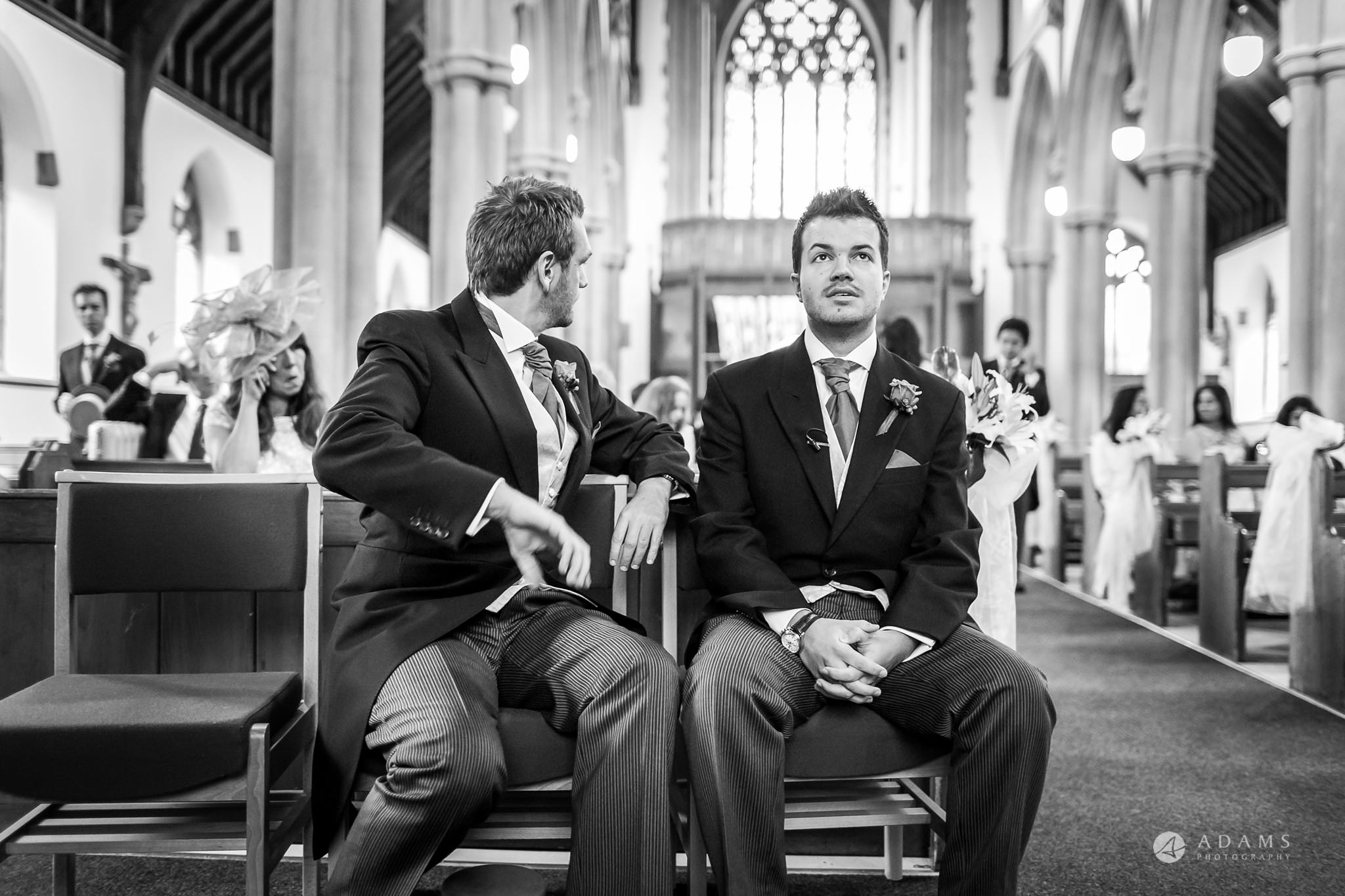St Audries Park wedding groom siting in the church looking up