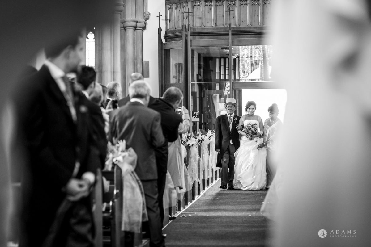 St Audries Park wedding bride walks down the aisle with her father