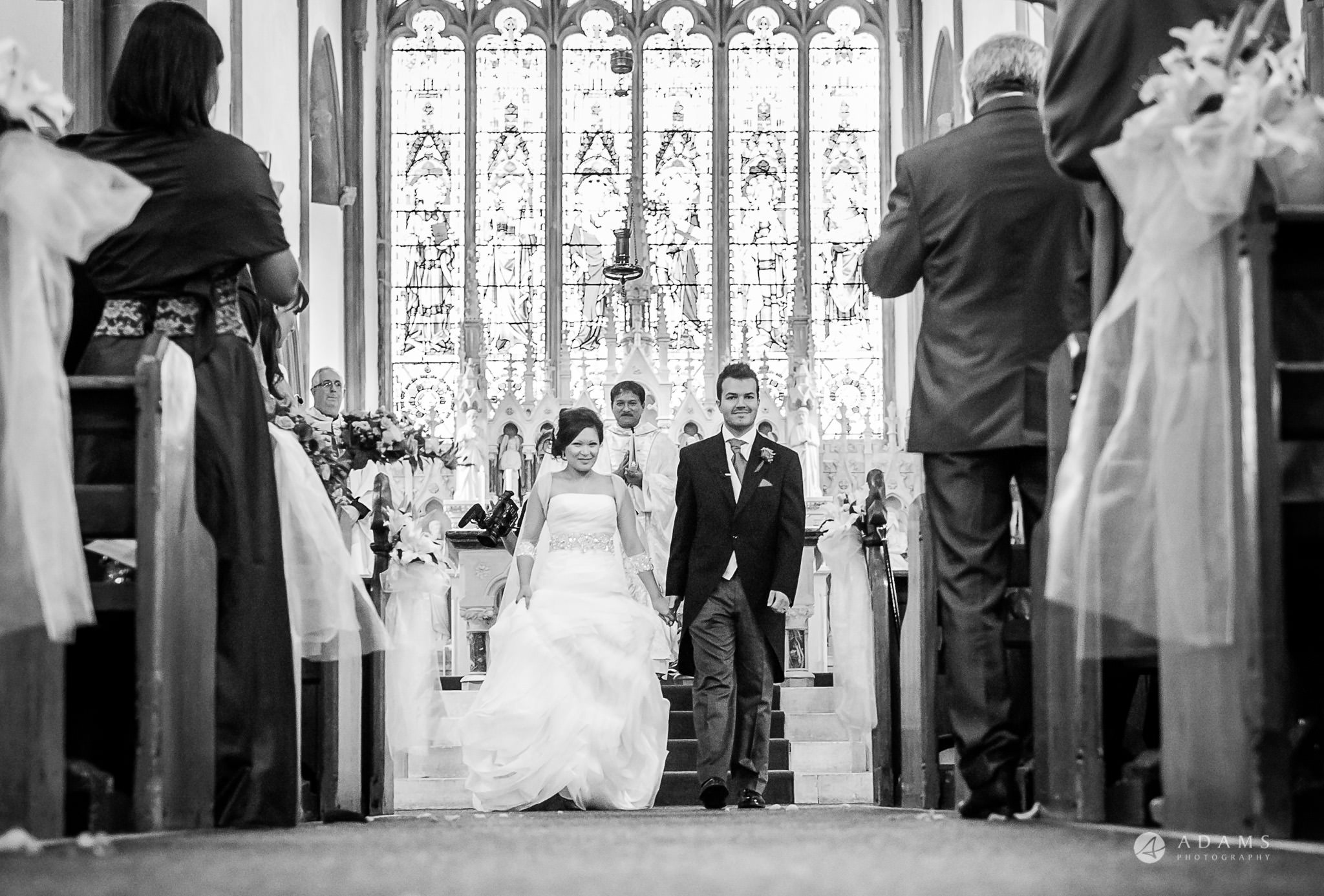 St Audries Park wedding the married couple leave the church