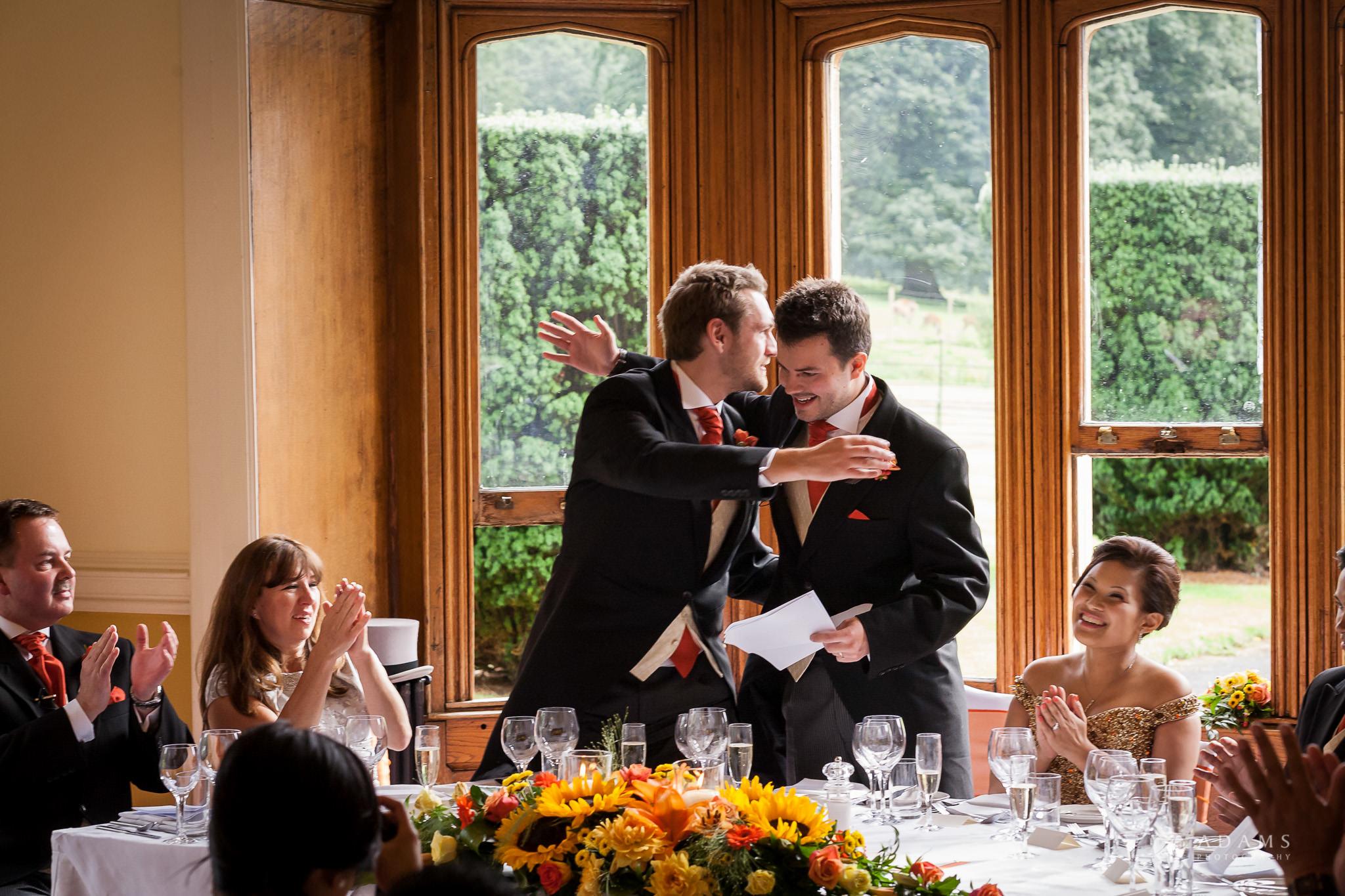St Audries Park wedding groom hugs his best man